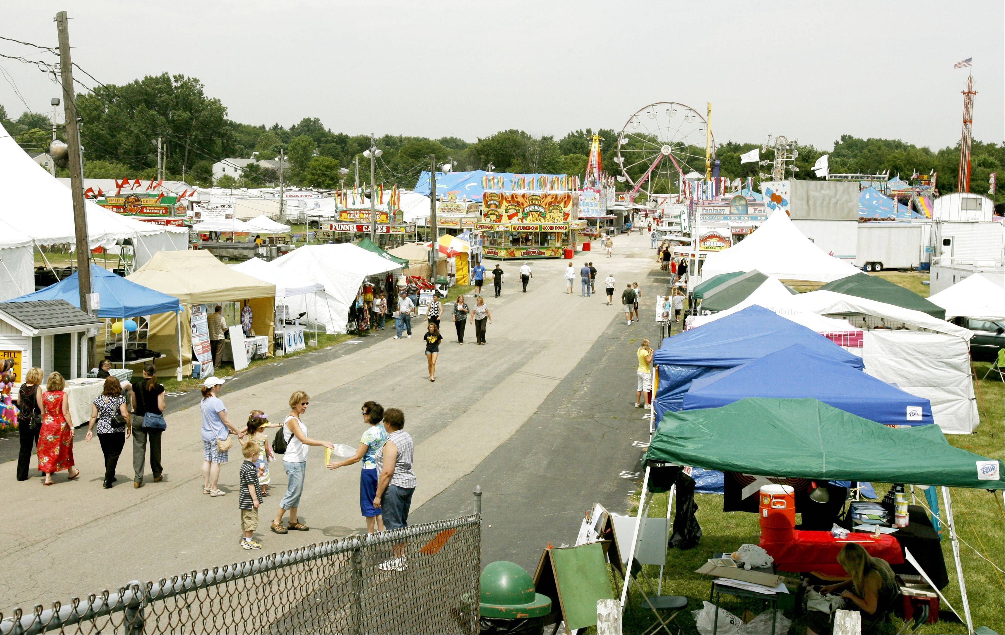 Fair-goers visit the first day of the DuPage County Fair.