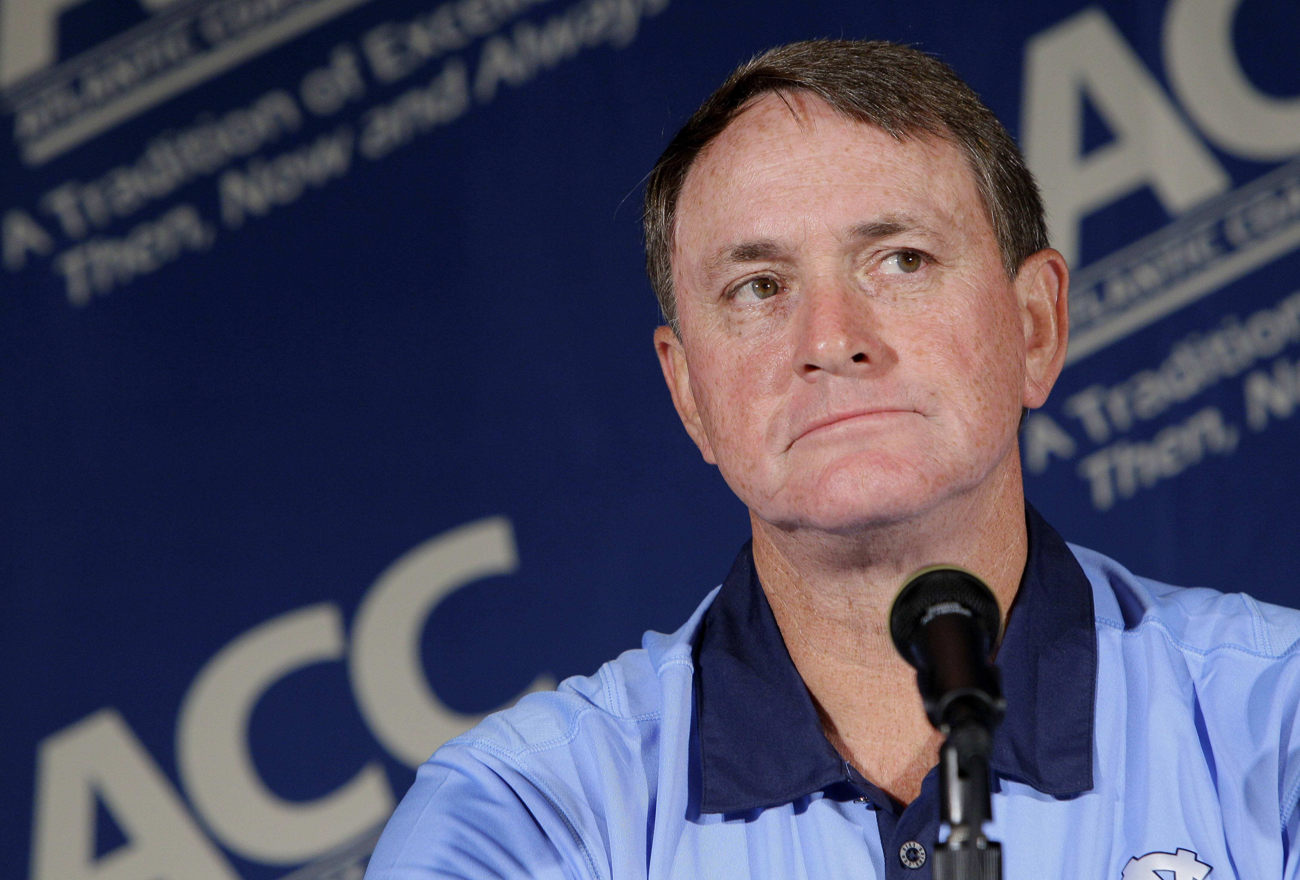 North Carolina coach Butch Davis pauses during interviews at the Atlantic Coast Conference Football Kickoff Monday in Pinehurst, N.C. University of North Carolina Chancellor Holden Thorp announced Wednesday that Davis has been dismissed as head coach of the football program.