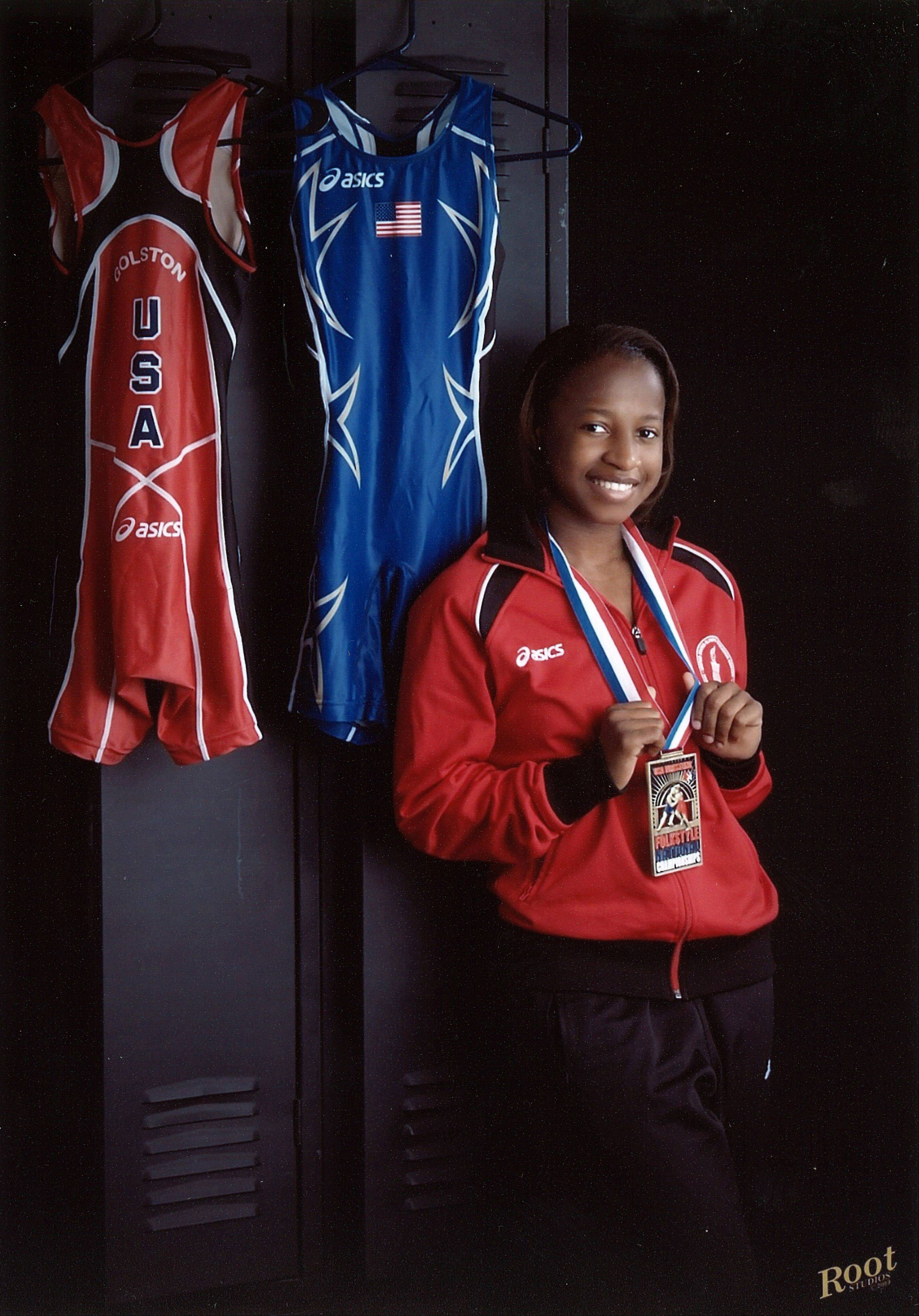 When her brother started winning wrestling medals, Erin Golston of Lake in the Hills decided at age 6 that she wanted some of her own.