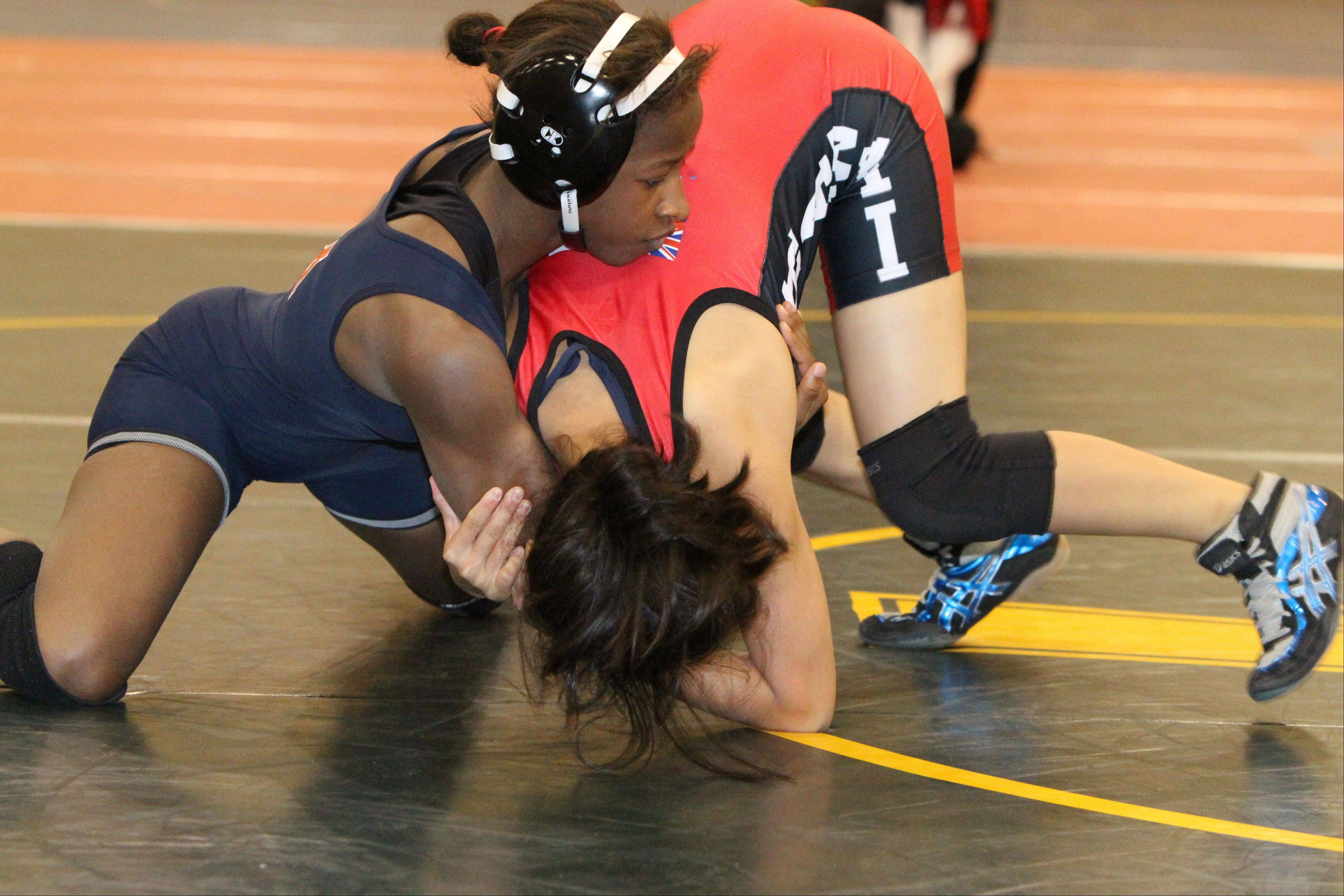 Erin Golston, left, takes control in her match against Allene Somera of Hawaii at the Body Bar Women's FILA Junior National Championships in Kissimmee, Fla. Golston won that round and continued on to win the May tournament. She's competing this week in the Junior World Championships in Romania.
