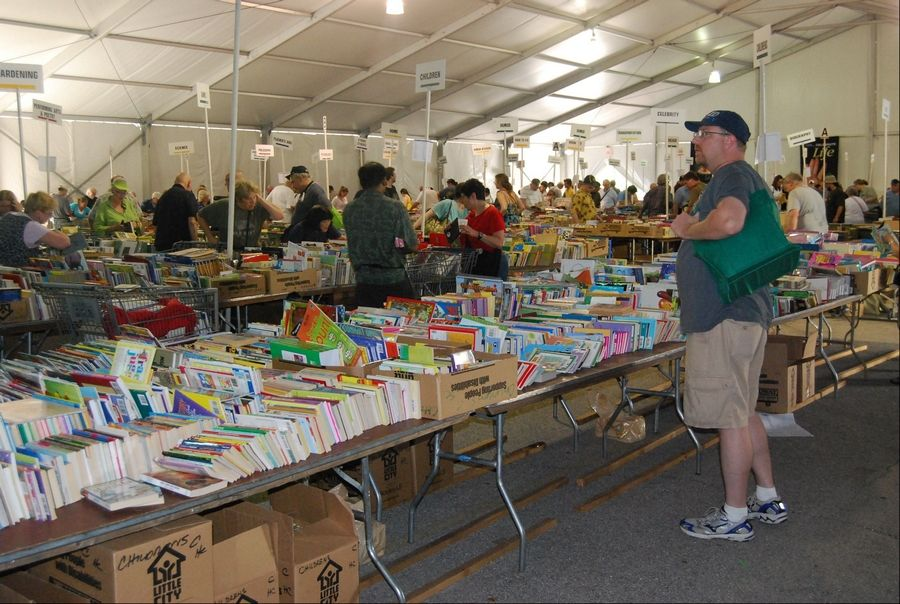Patrons browse thousands of books at last year's Little City Book Fair, which is being relocated from Skokie to Harper College in Palatine.
