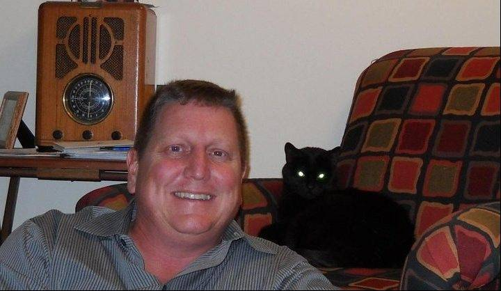 "Roger Blakely of Arlington Heights, author of the novel ""Chief,"" lives with his cat -- as does his protagonist."