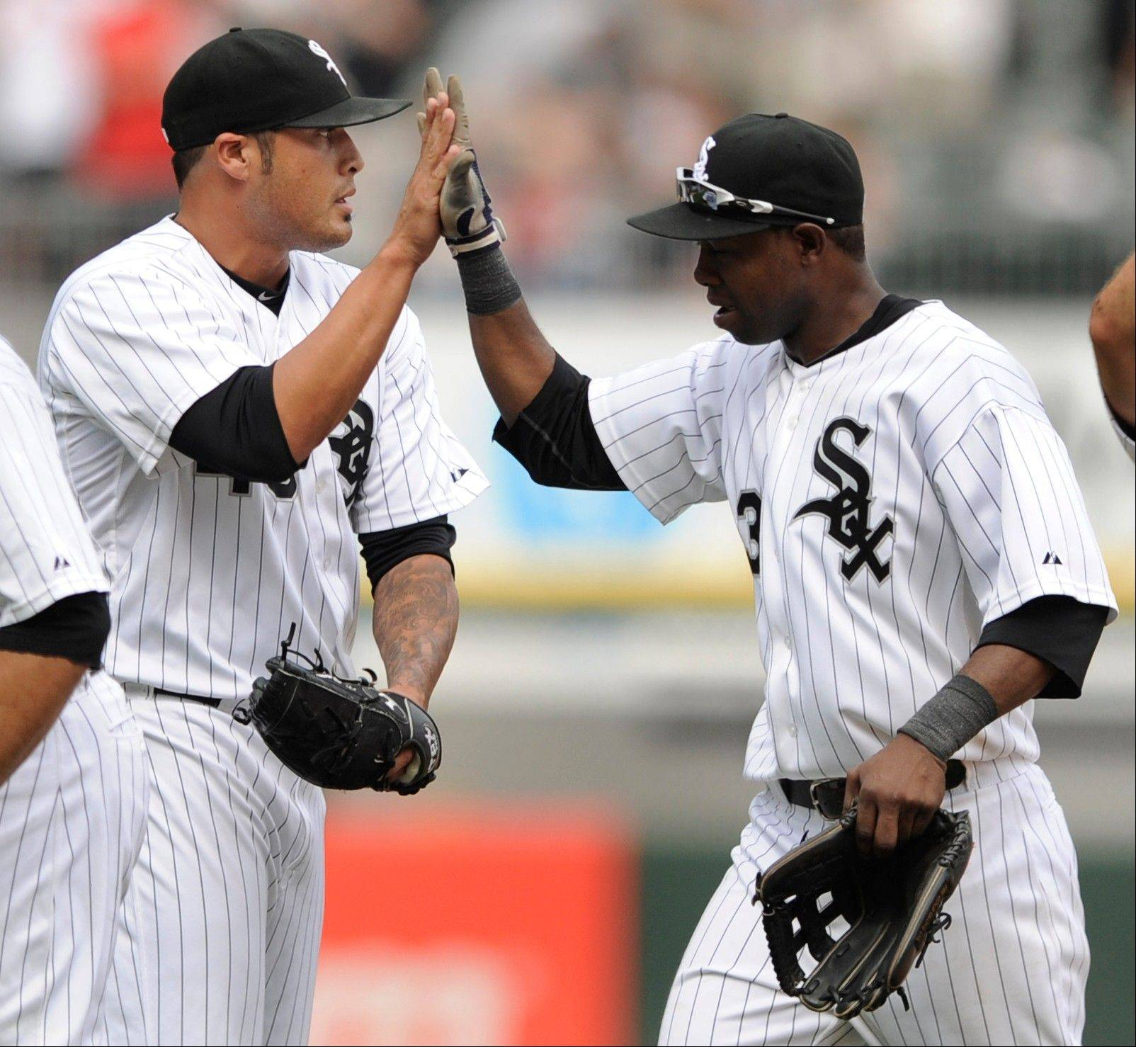Chicago White Sox closing pitcher Sergio Santos left, celebrates with teammate Alejandro De Aza after defeating the Detroit Tigers 2-1 Wednesday at U.S. Cellular Field.