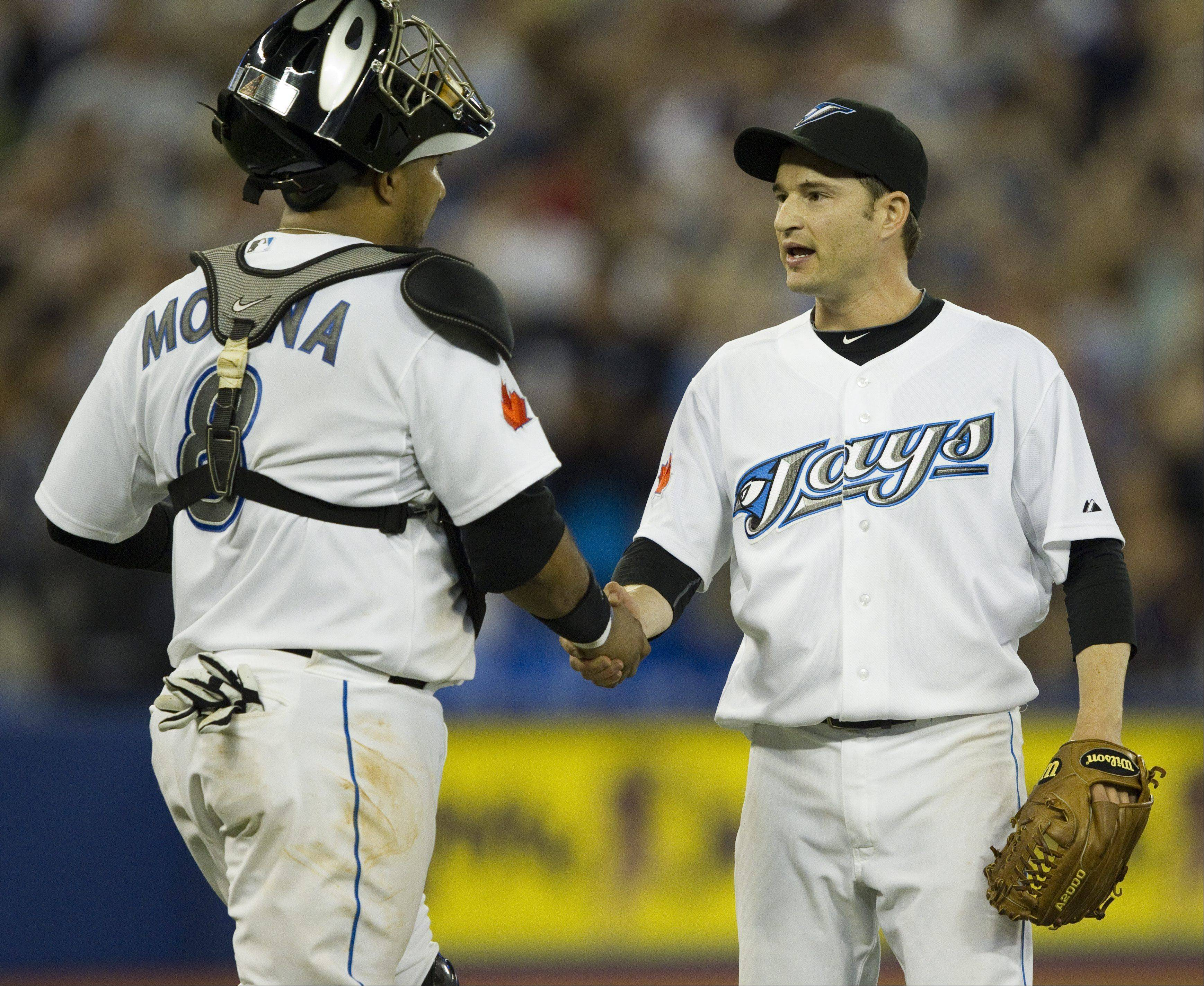 Toronto Blue Jays pitcher Jason Frasor has been a dependable reliever, and the White Sox acquired the Chicago native in a four-player deal on Wednesday.