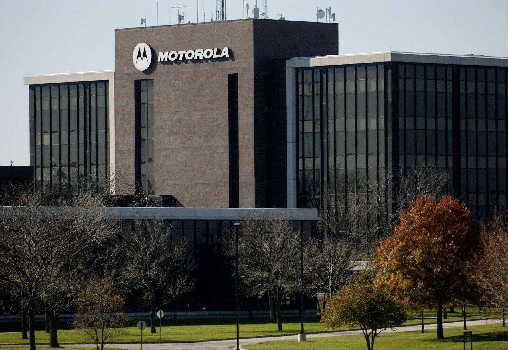 Motorola Solutions Inc., the maker of bar-code scanners and walkie-talkies, will buy back as much as $2 billion worth of its shares and begin paying a dividend after selling its networks unit and cutting debt.