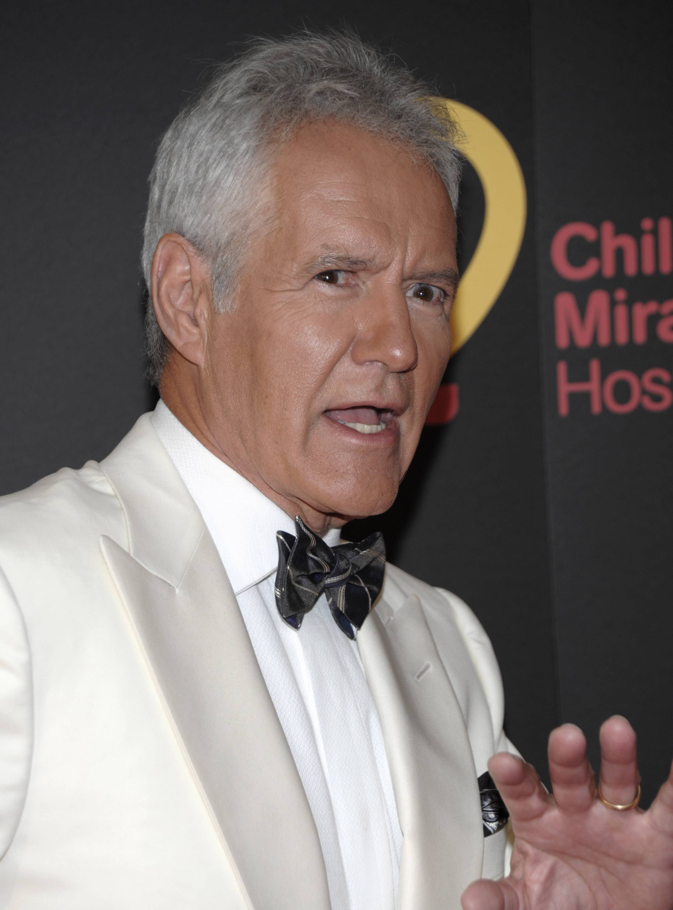 Alex Trebek says he snapped his Achilles tendon while running after a burglar who had stolen items from his San Francisco hotel room.