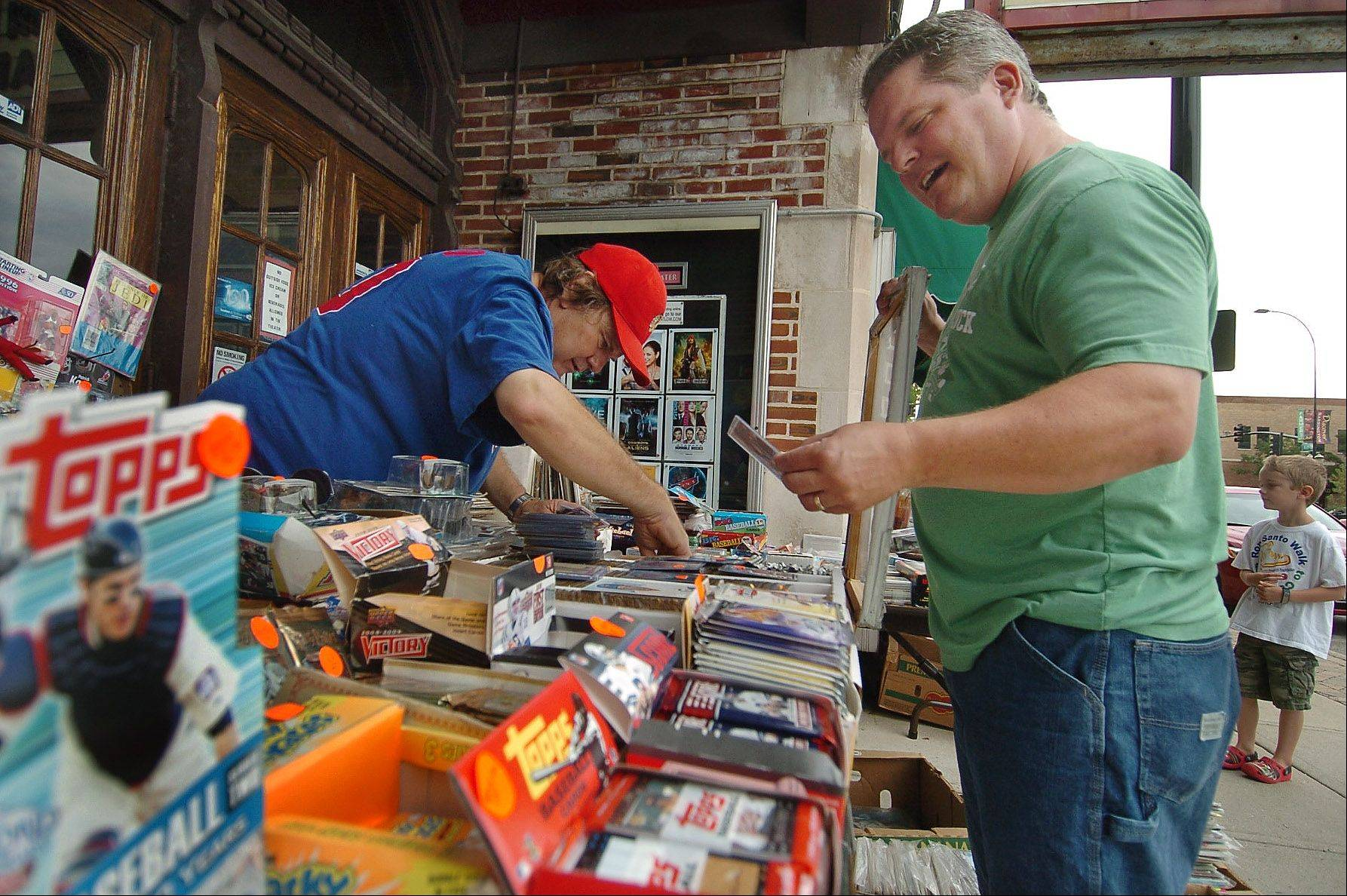 Rick Hucker of Barrington finds a Ron Santo card from sports card dealer Gary Rapata of Elk Grove Village on the first day of the Barrington Sidewalk Days.
