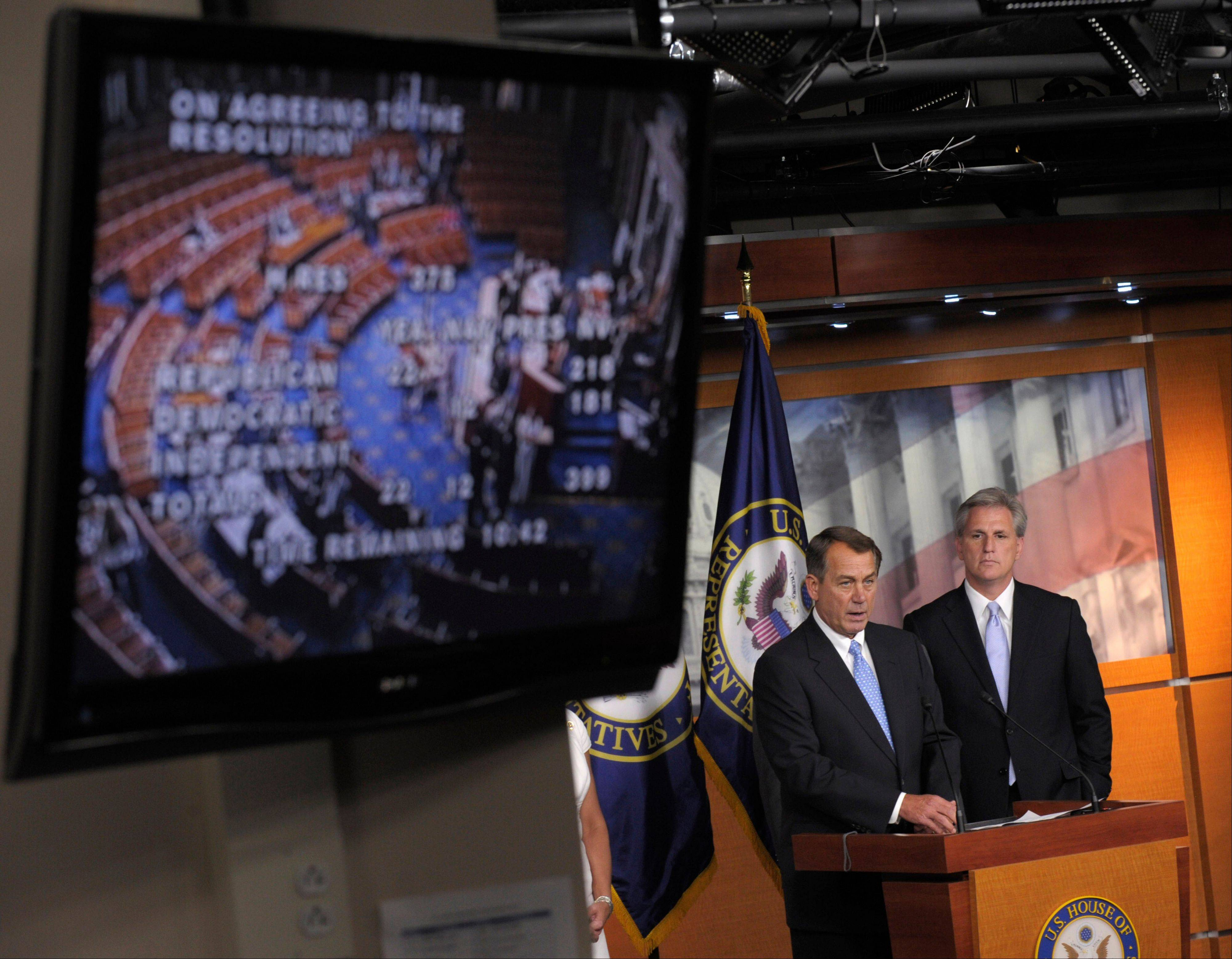 House Speaker John Boehner of Ohio, left, accompanied by House Majority Whip Kevin McCarthy of California, speaks during a news conference on Capitol Hill Thursday.