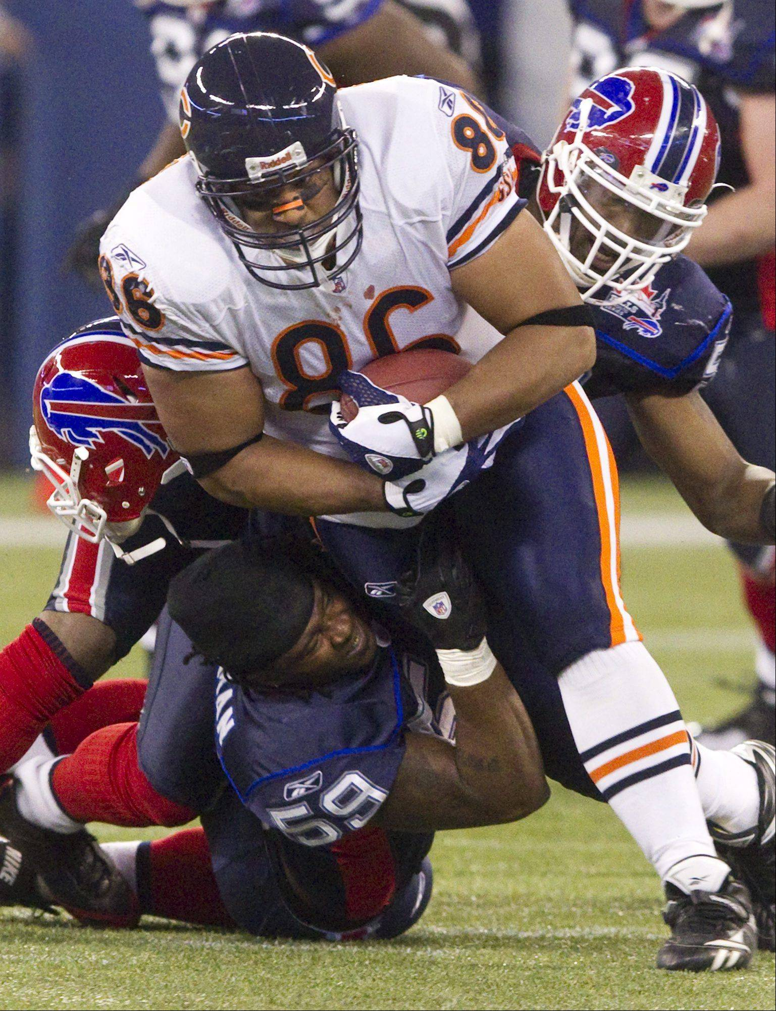 The Bears released tight end Brandon Manumaleuna, here making a catch against the Buffalo Bills last season, after he failed a physical Thursday.