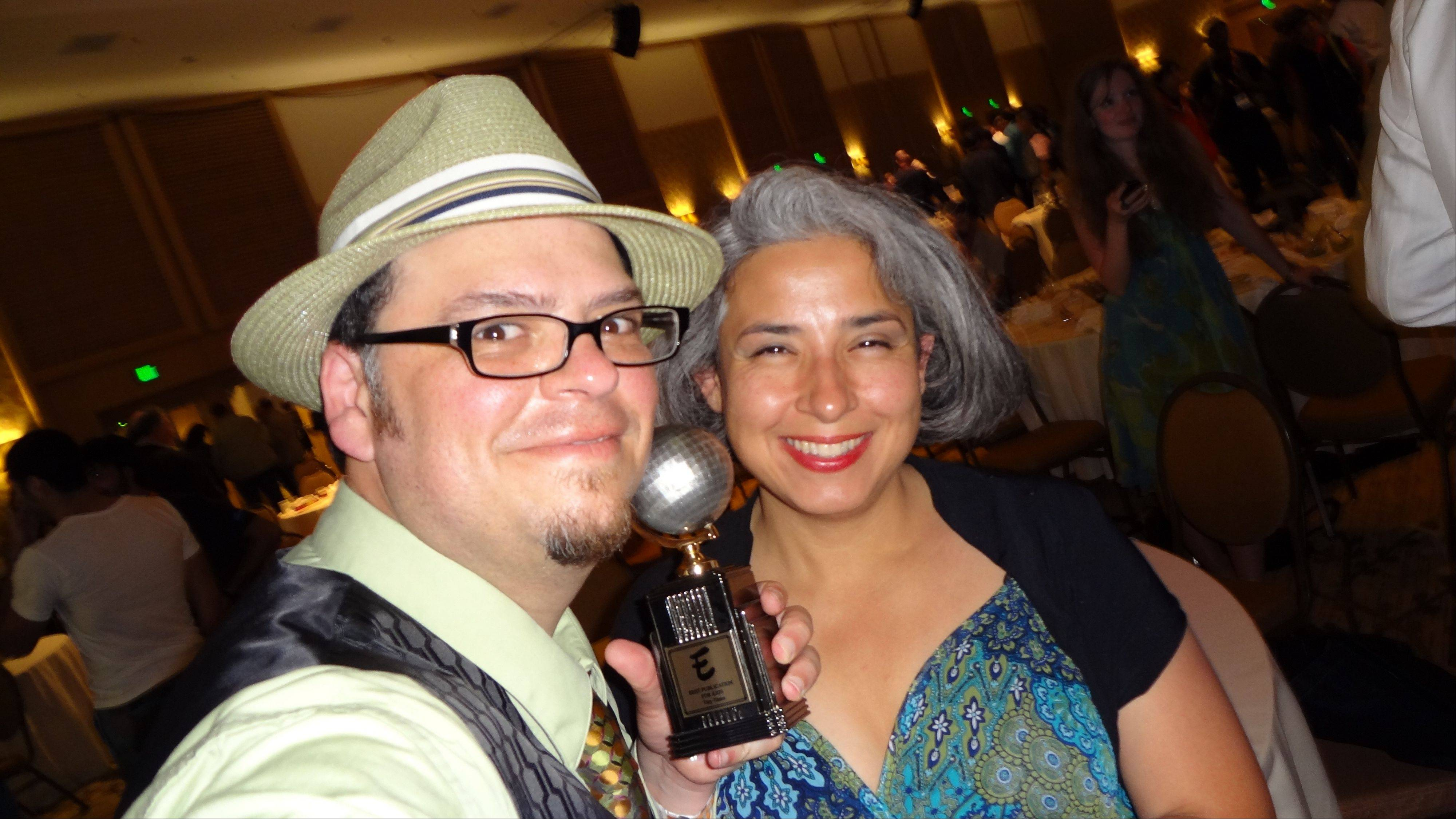 "Art Baltazar and his wife, Rose, pose on July 22 at the San Diego Comic-Con after Baltazar won an Eisner Award for his work with ""Tiny Titans."""