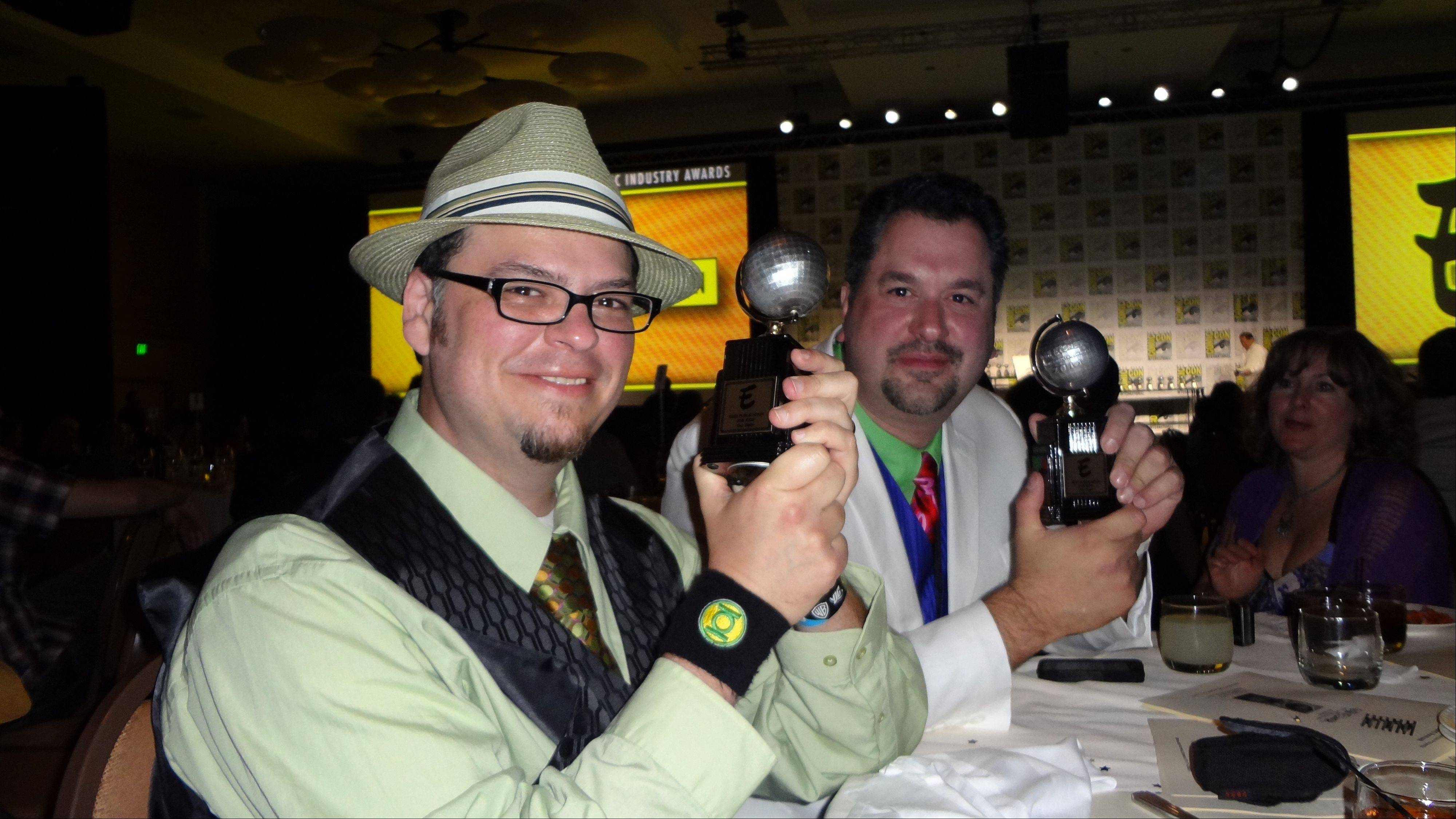 Art Baltazar and Franco Aureliani pose on July 22 at the San Diego Comic-Con with their new Eisner Awards.