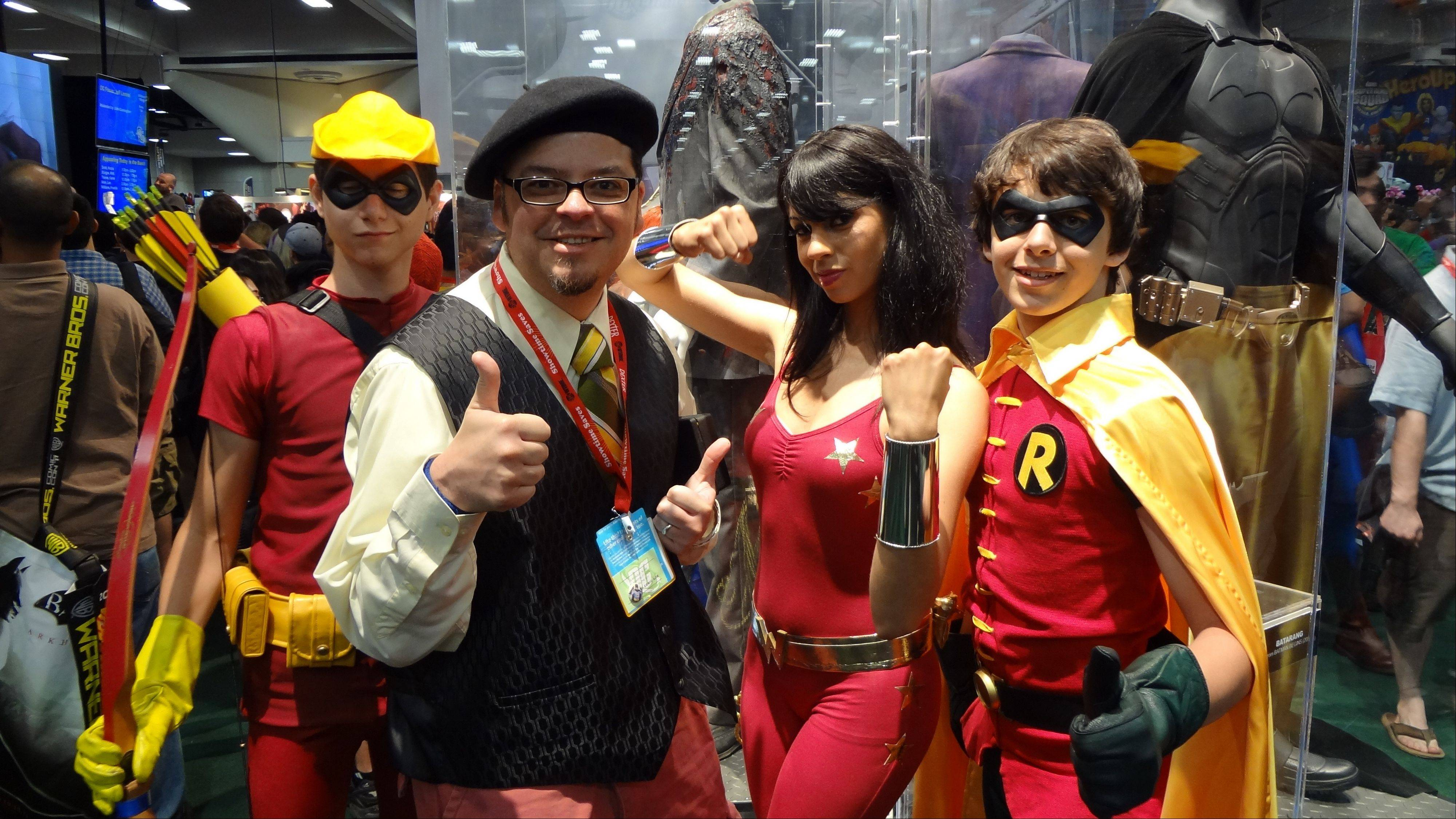 Art Baltazar of Streamwood poses at the San Diego Comic-Con with fans dressed up as the Teen Titans. These DC Comics characters are Speedy, Wonder Girl and Robin.