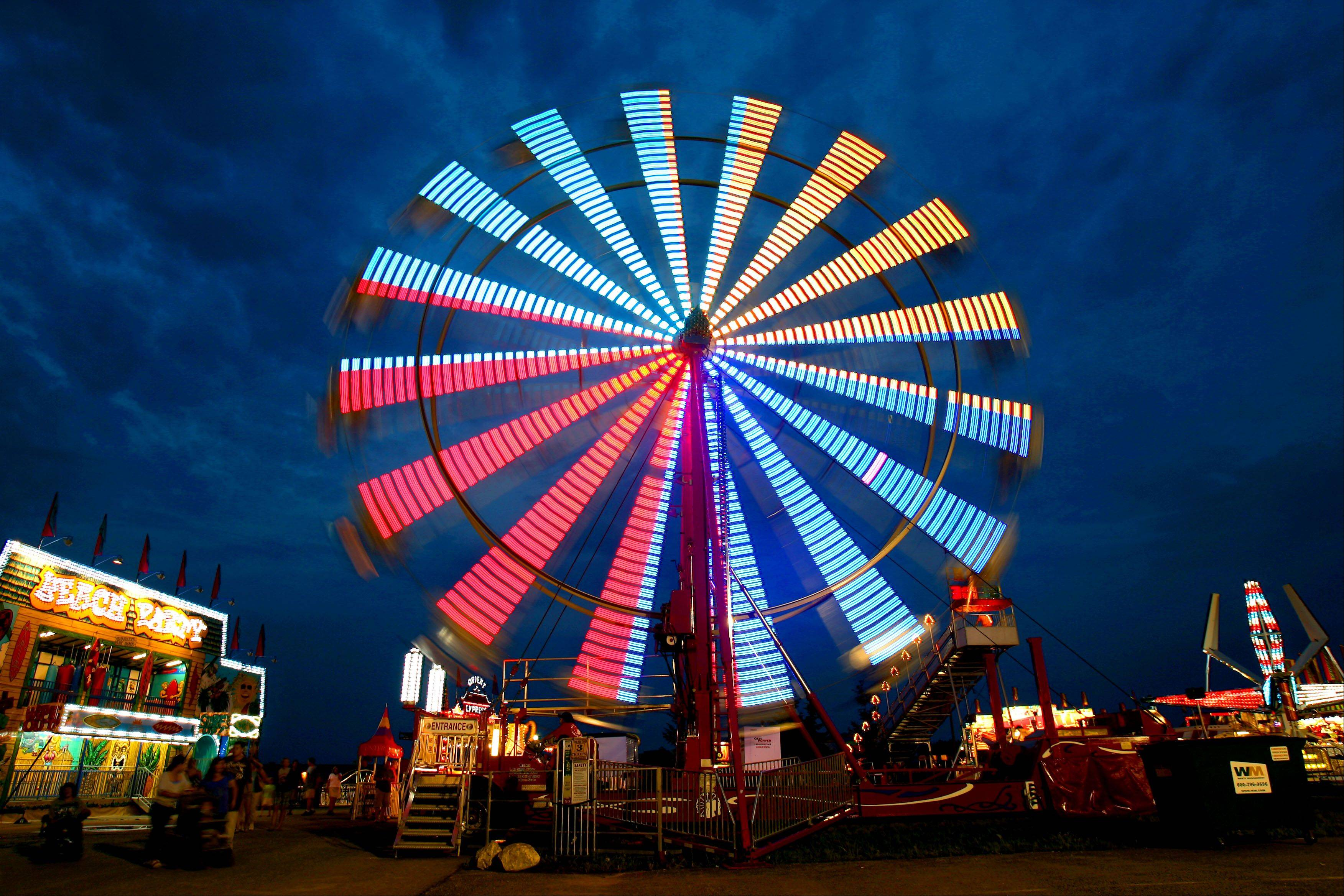 The Ferris Wheel spins in the evening sky during the Lake County Fair Wednesday in Grayslake.
