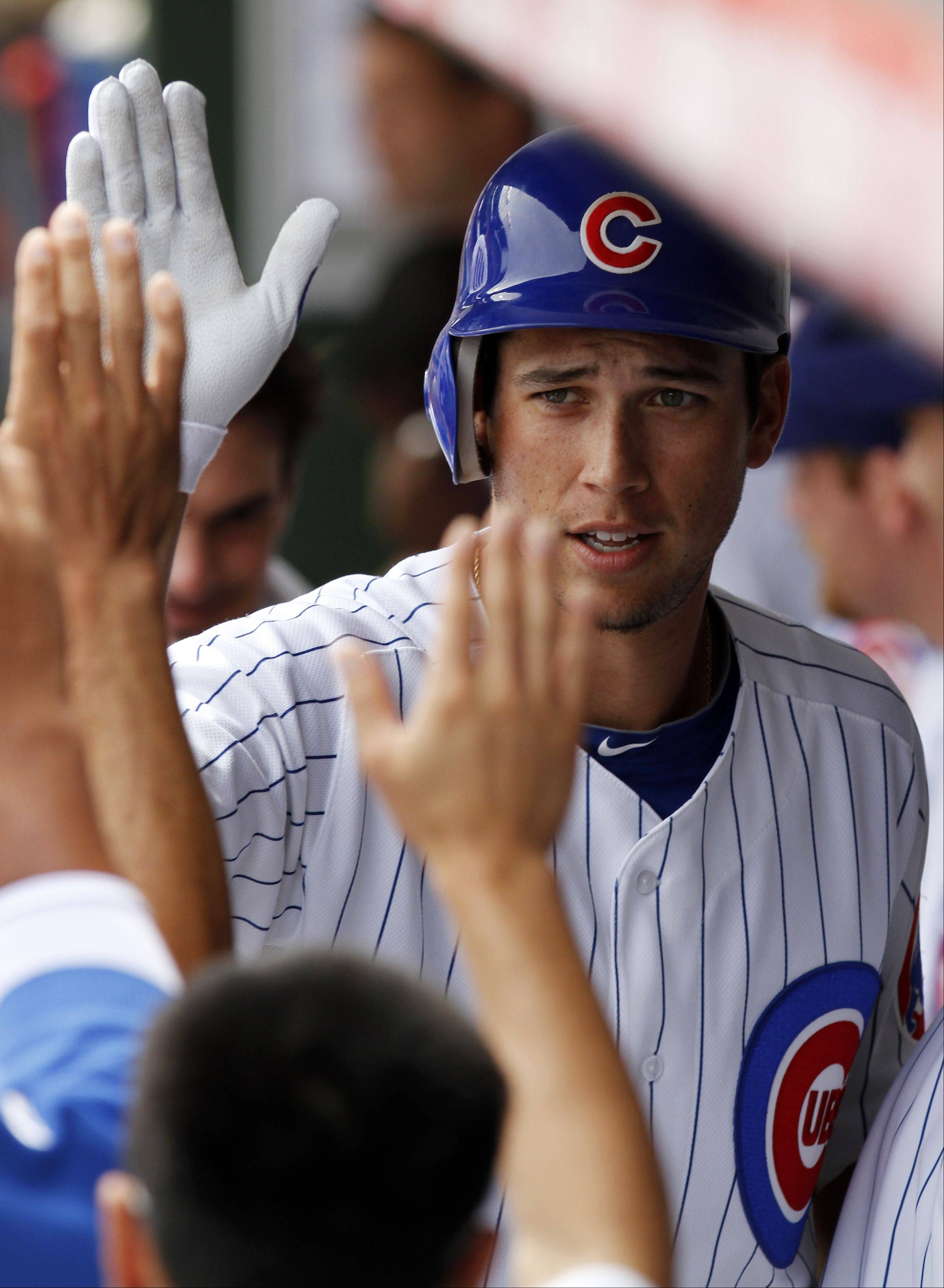 Chicago Cubs Tyler Colvin Celebrates With Teammates In The Dugout After Hitting A Solo Home
