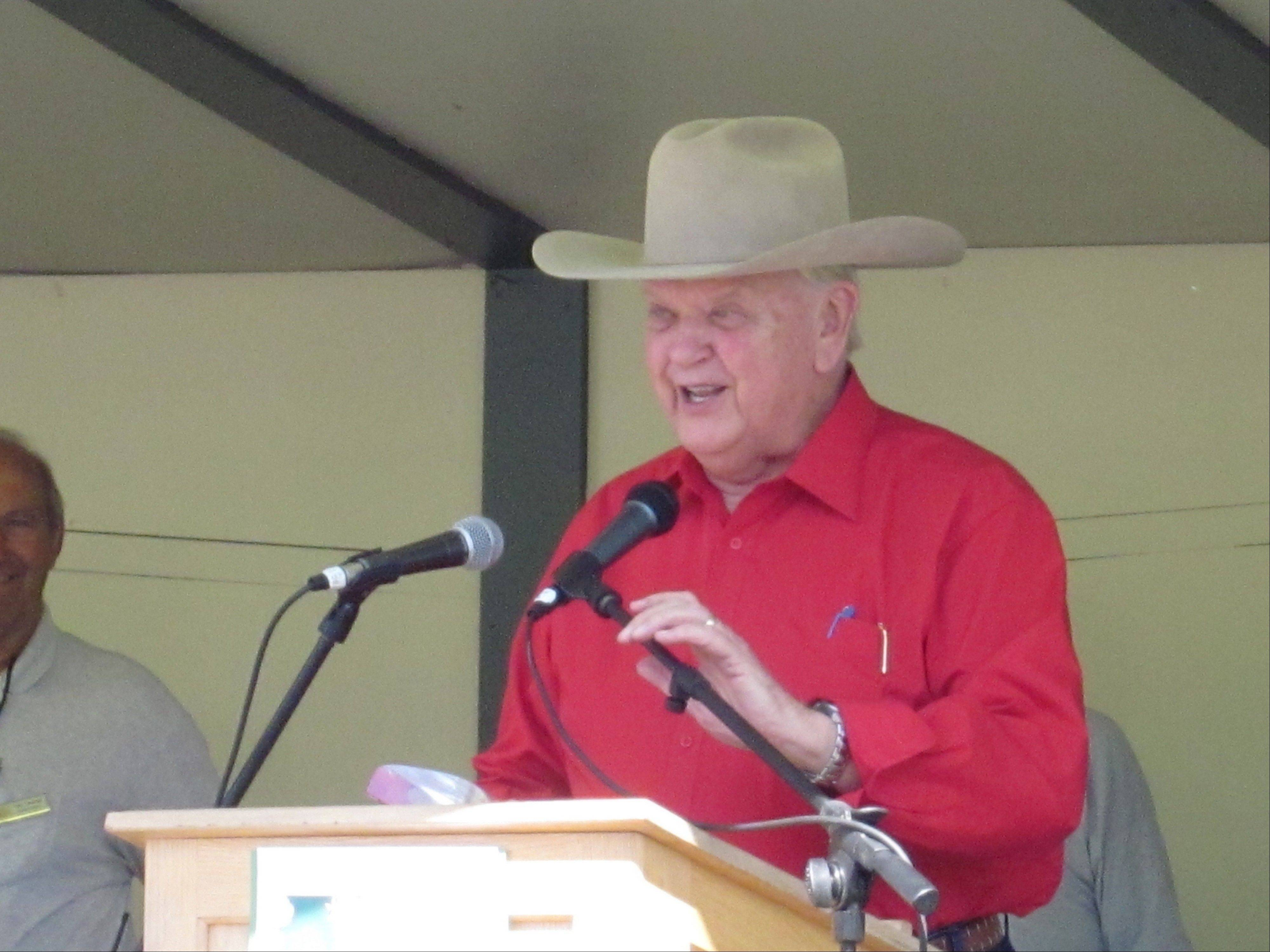 "Legendary agriculture reporter Orion Samuelson addresses the crowd at the Lake County Fair on Friday after receiving a lifetime achievement award. Samuelson told young farmers at the fair to ""dream big."""