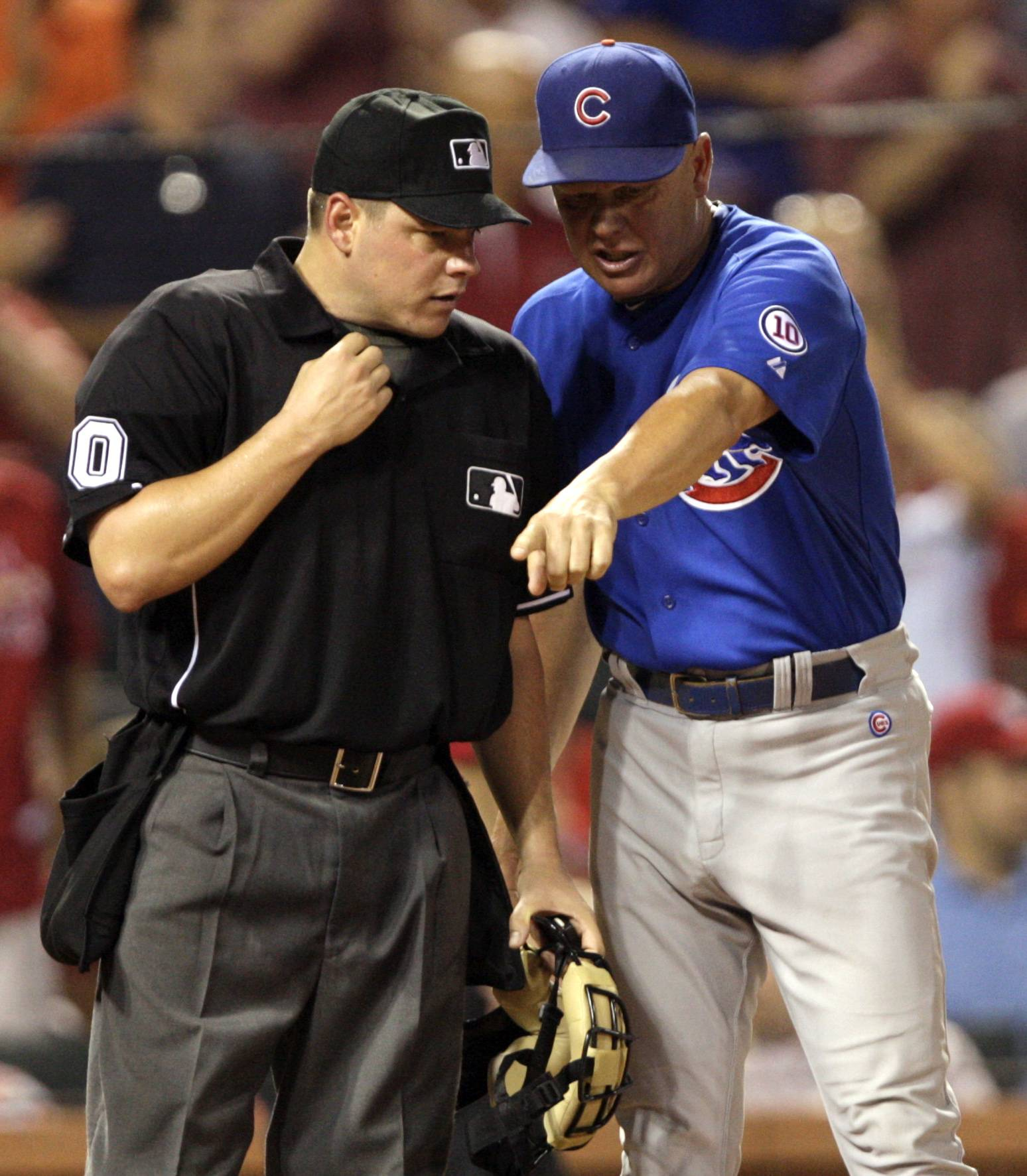Mike Quade argues a call at the plate Friday with home plate umpire D.J. Reyburn in the seventh inning.