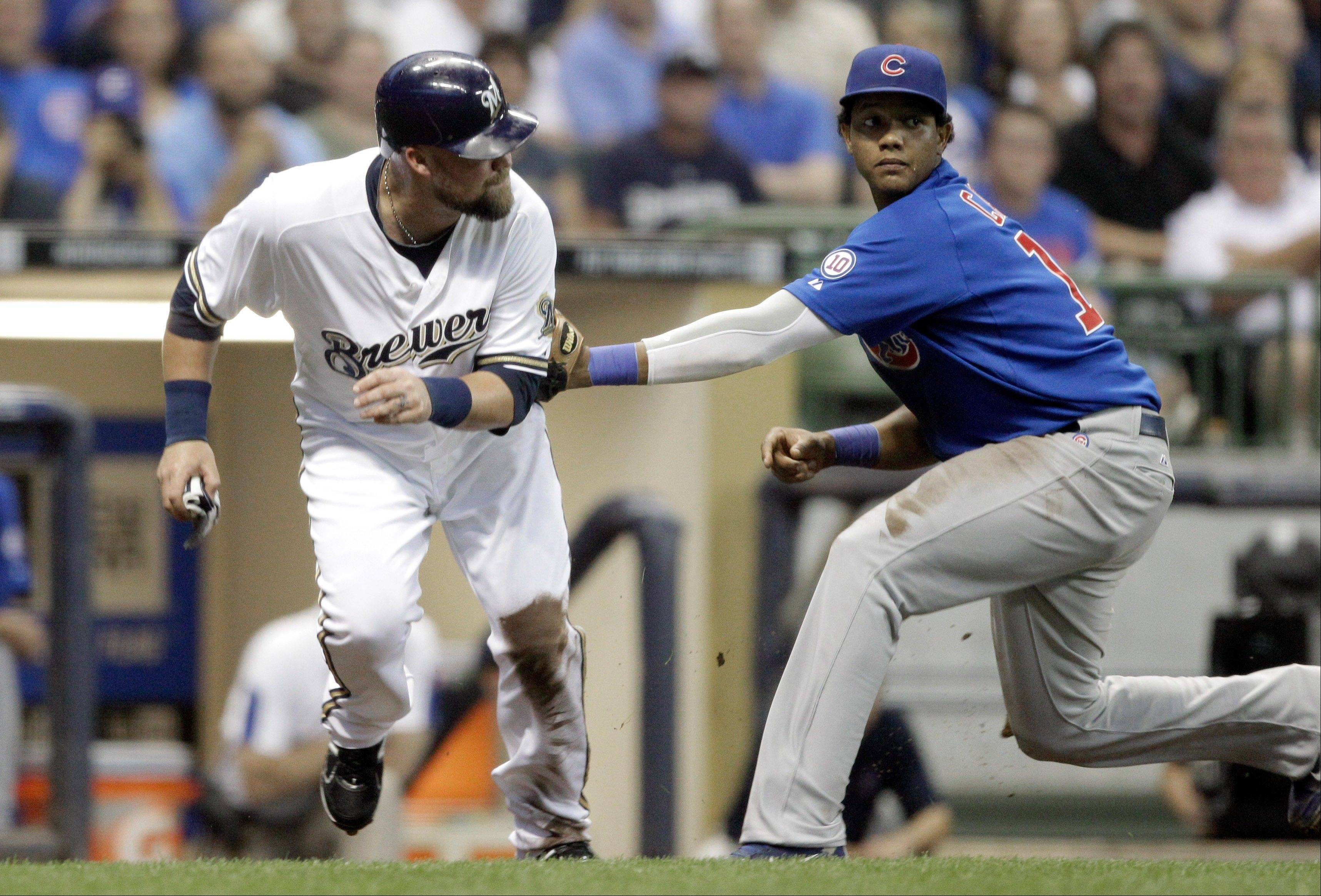 Casey McGehee is tagged out by Starlin Castro after being caught in a rundown during the second inning Wednesday.