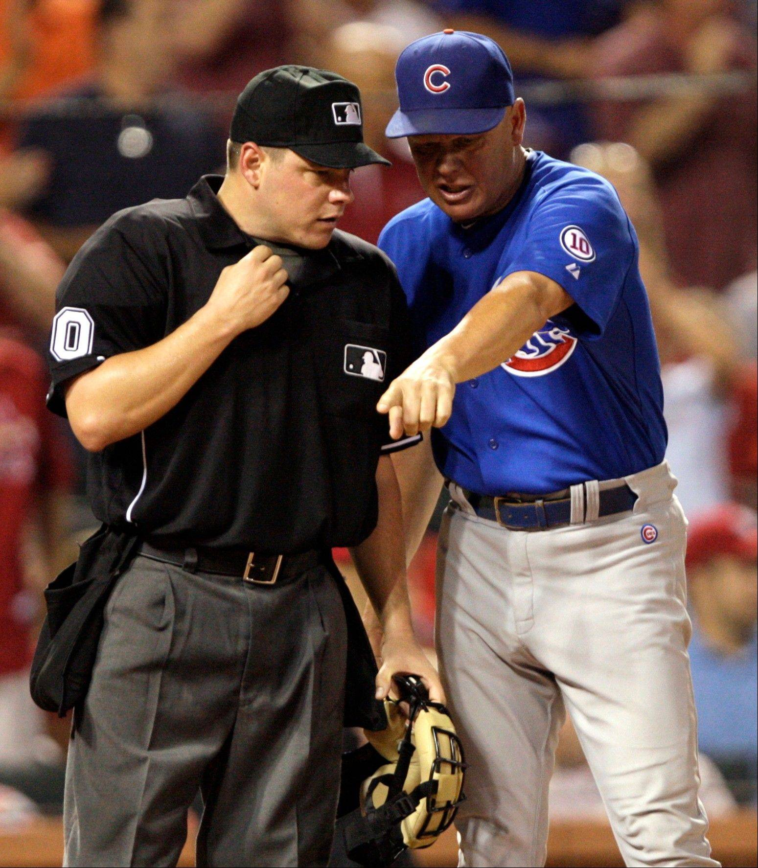 Cubs manager Mike Quade argues a call at the plate with home plate umpire D.J. Reyburn in the seventh inning Friday.