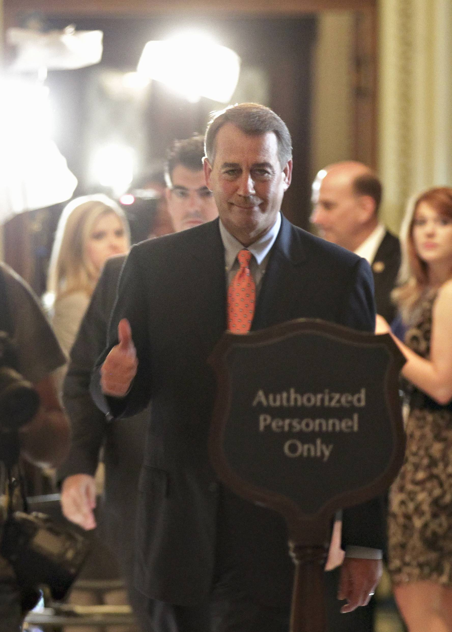 John Boehner leaves the House Chamber Friday after House passage of his debt-limit legislation that was rewritten overnight to win the support of conservative holdouts.