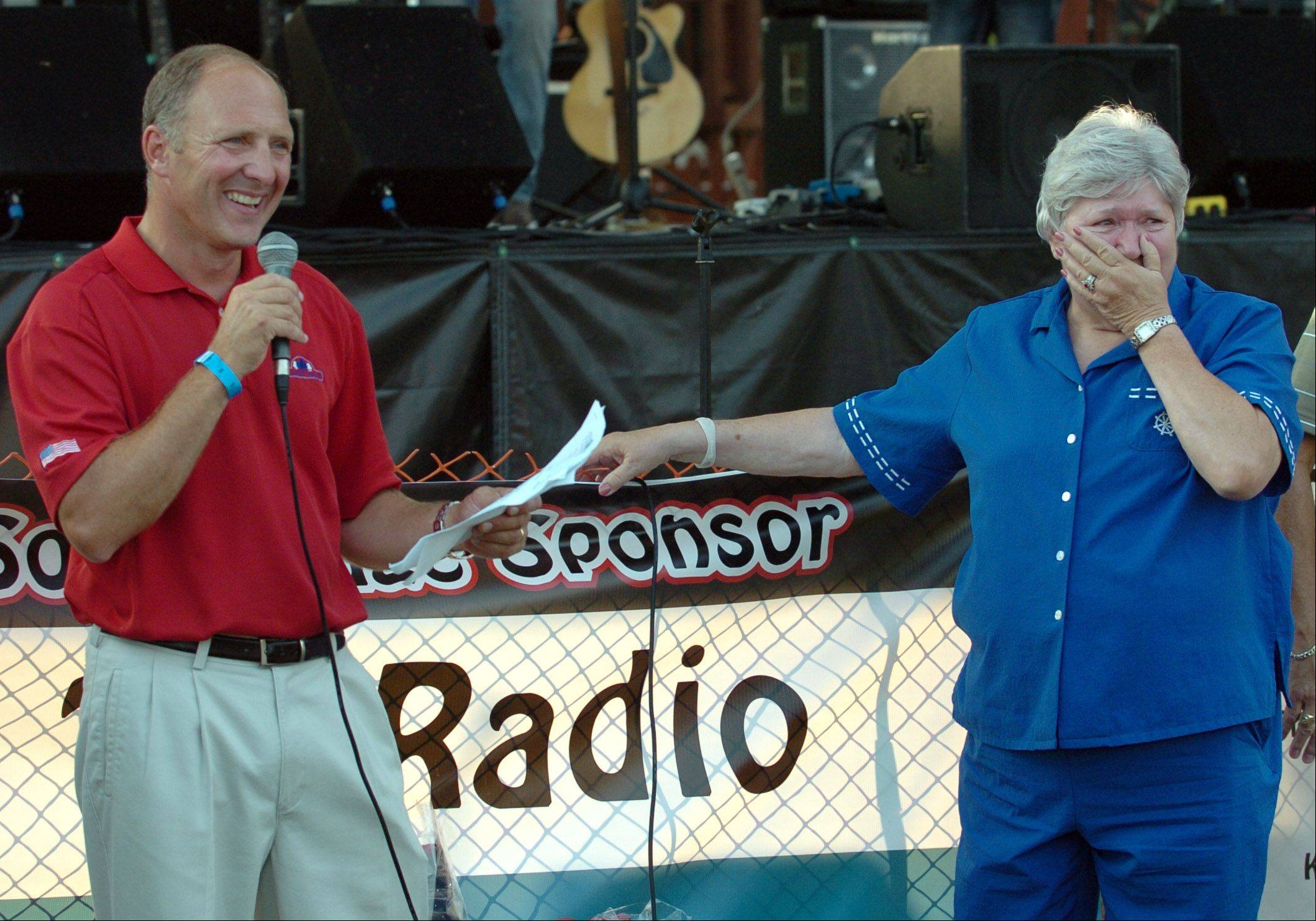 Kristin Ackmann/kackmann@dailyherald.com On behalf of the Village of Sugar Grove and the Sugar Grove Chamber of Commerce and Industry, village president Sean Michels(cq), named Lil Adams the Sugar Grove Citizen of the Year, at the Sugar Grove Corn Boil on Friday. Lil has been a resident of Sugar Grove for forty-four years, and runs the Sugar Grove Township Community House voluntarily.