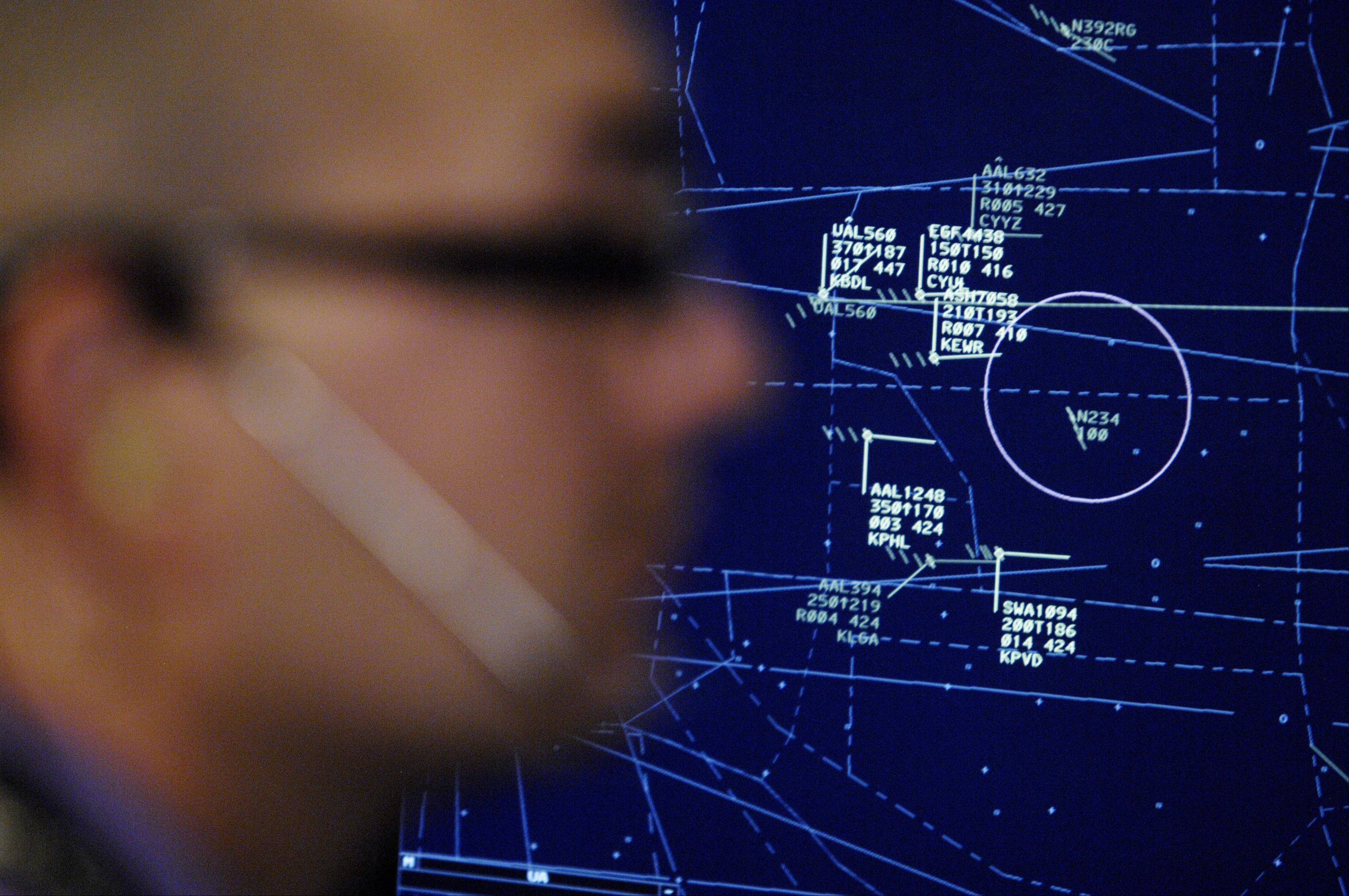 Air Traffic Controller Brad Wilcko of Oswego works on simulated flights in the training room in the Air Route Traffic Control Center in Aurora.