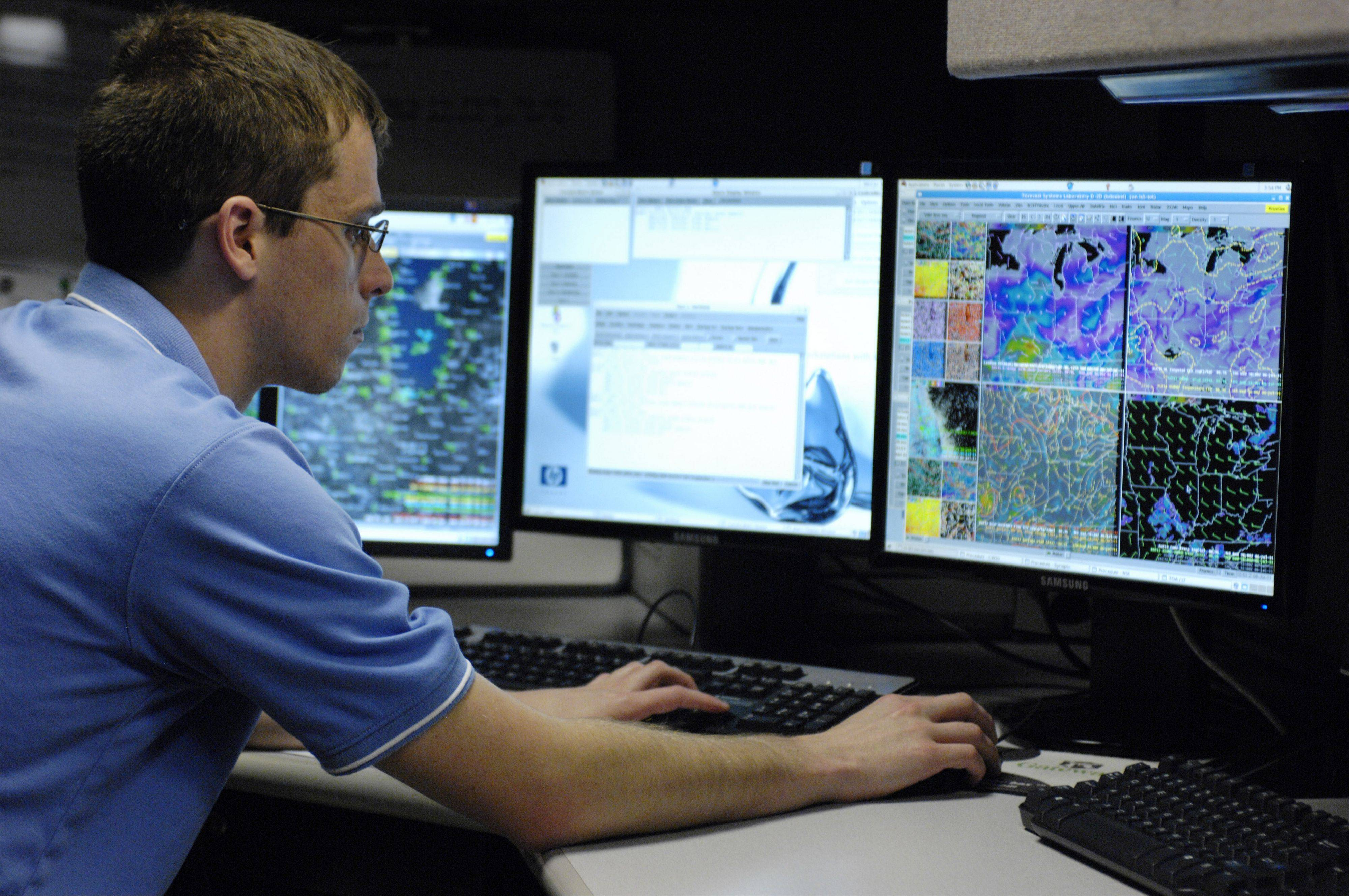 National Weather Service Meteorologist Ben Deubelbeiss works in the weather center of the FAA Chicago Air Route Traffic Control Center in Aurora.