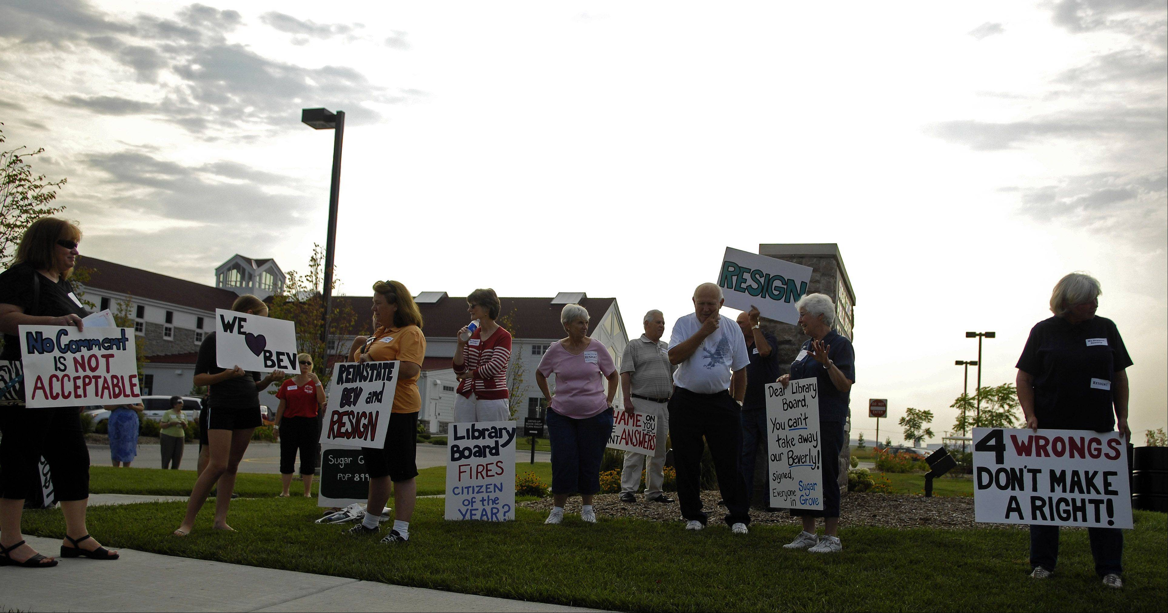 Citizens for a Better Sugar Grove protest the firing of Sugar Grove Library Director Beverly Holmes Hughes before Thursday's library board meeting.