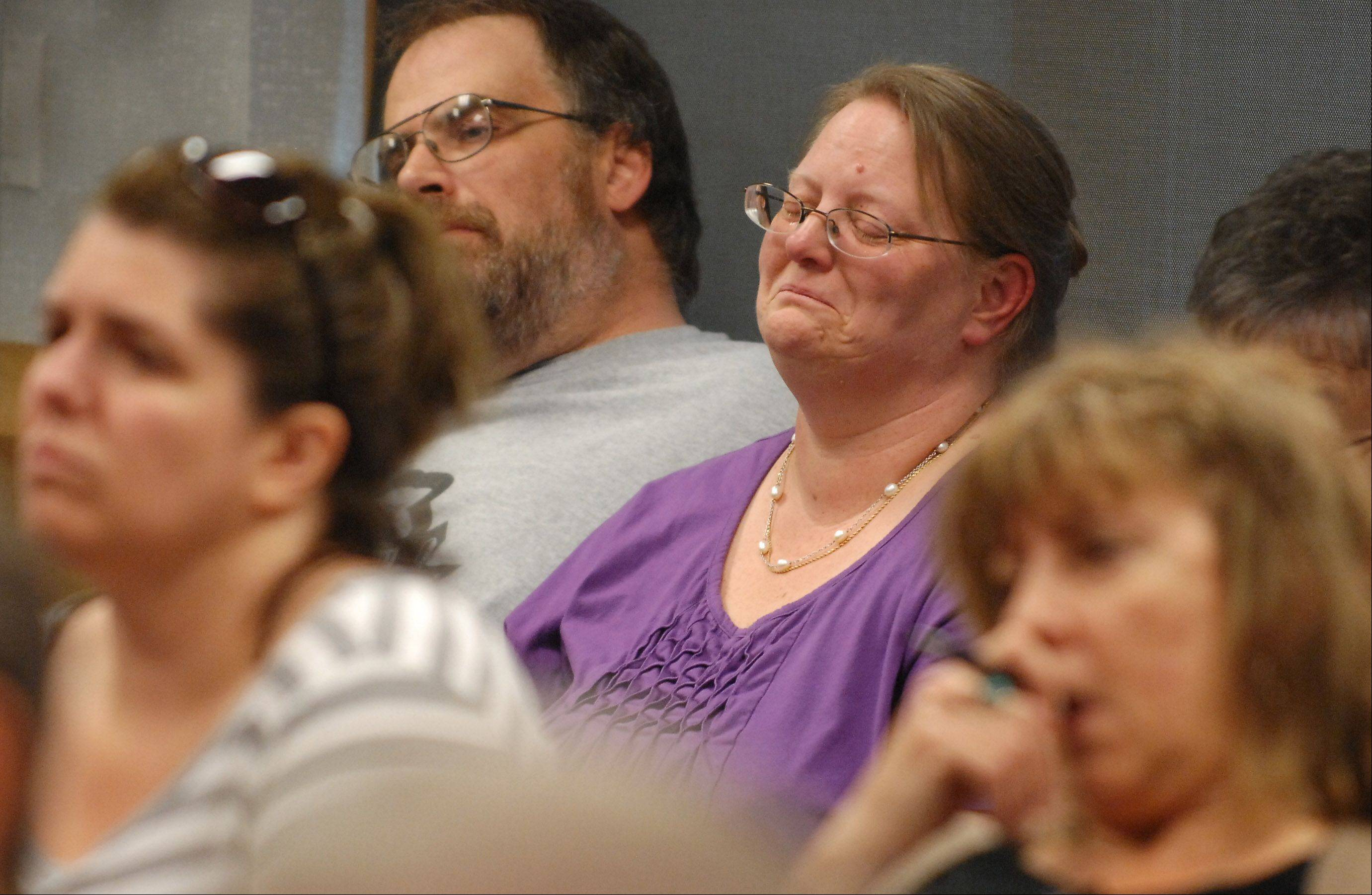 Fired Sugar Grove library Director Beverly Holmes Hughes gets emotional as numerous members of the community speak on her behalf during Thursday's library board meeting.