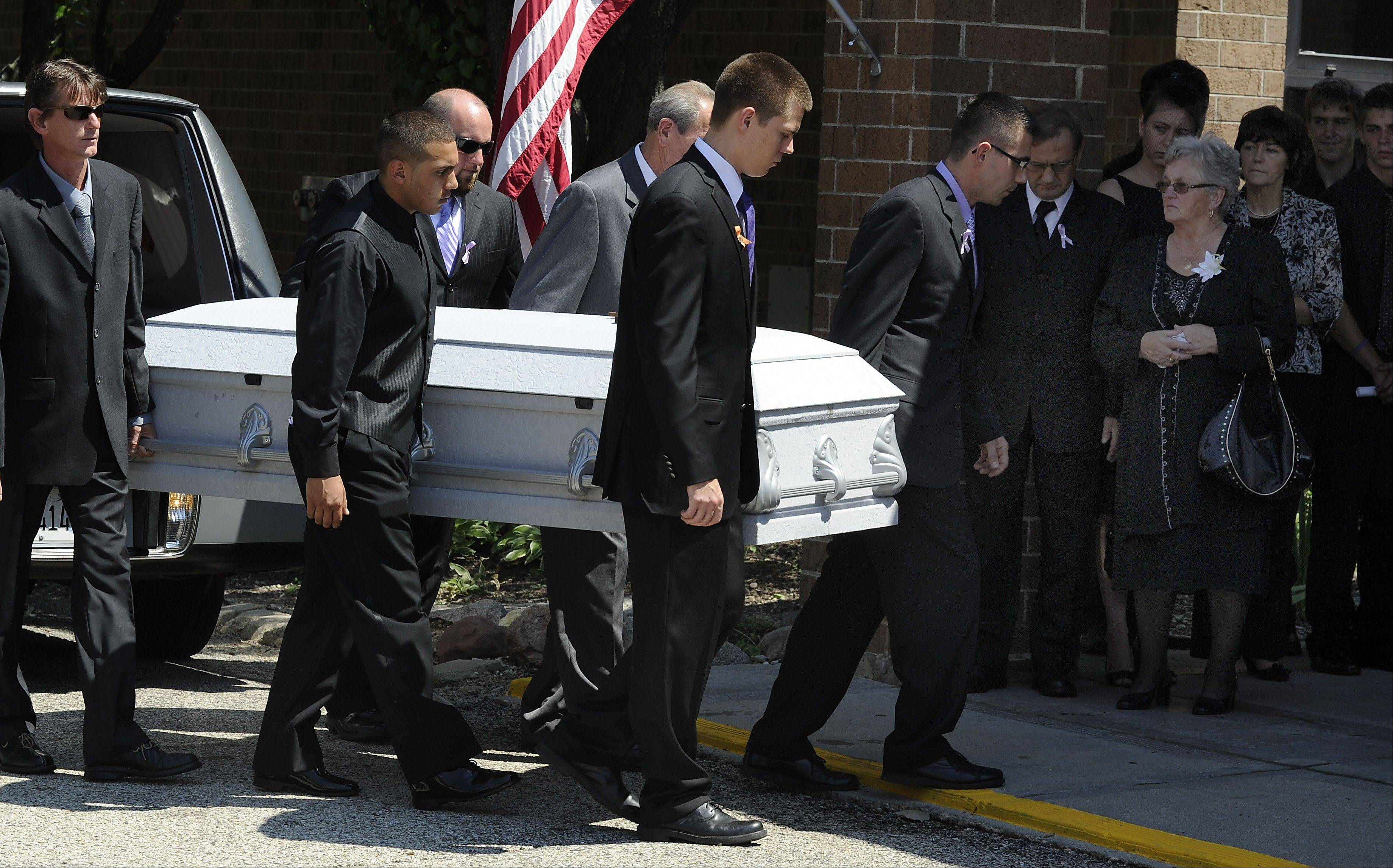 Gabriella Drozdz of Lake Zurich, who was killed in a hit-and-run accident, is carried into the St. Francis de Sales Catholic Church in Lake Zurich on Saturday.