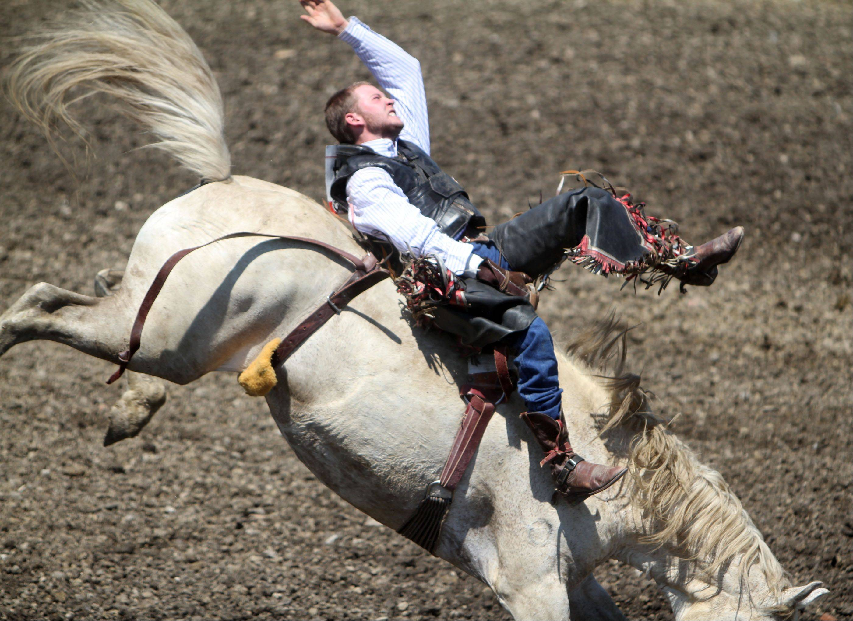 Aaron Boyer competes in bronco busting in the Lake County Fair Rodeo in Grayslake on Saturday.