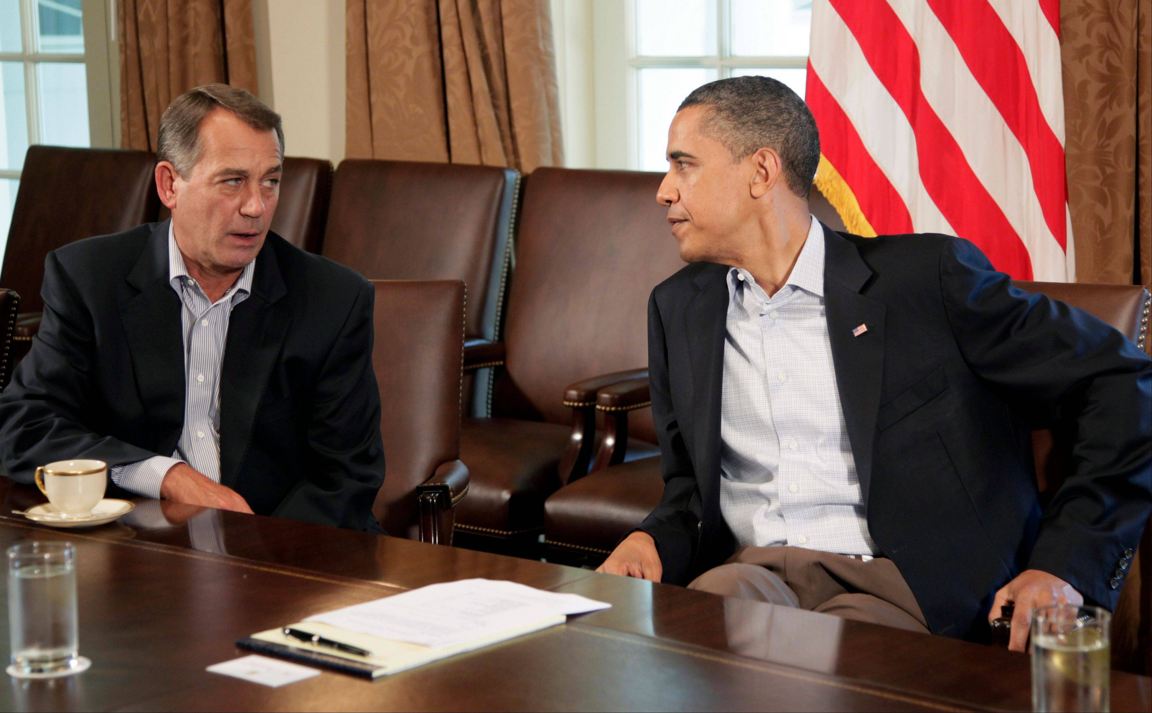 President Barack Obama and House Speaker John Boehner of Ohio, left, in the Cabinet Room of the White House, Saturday, July 23, 2011, in Washington, to discuss the debt.