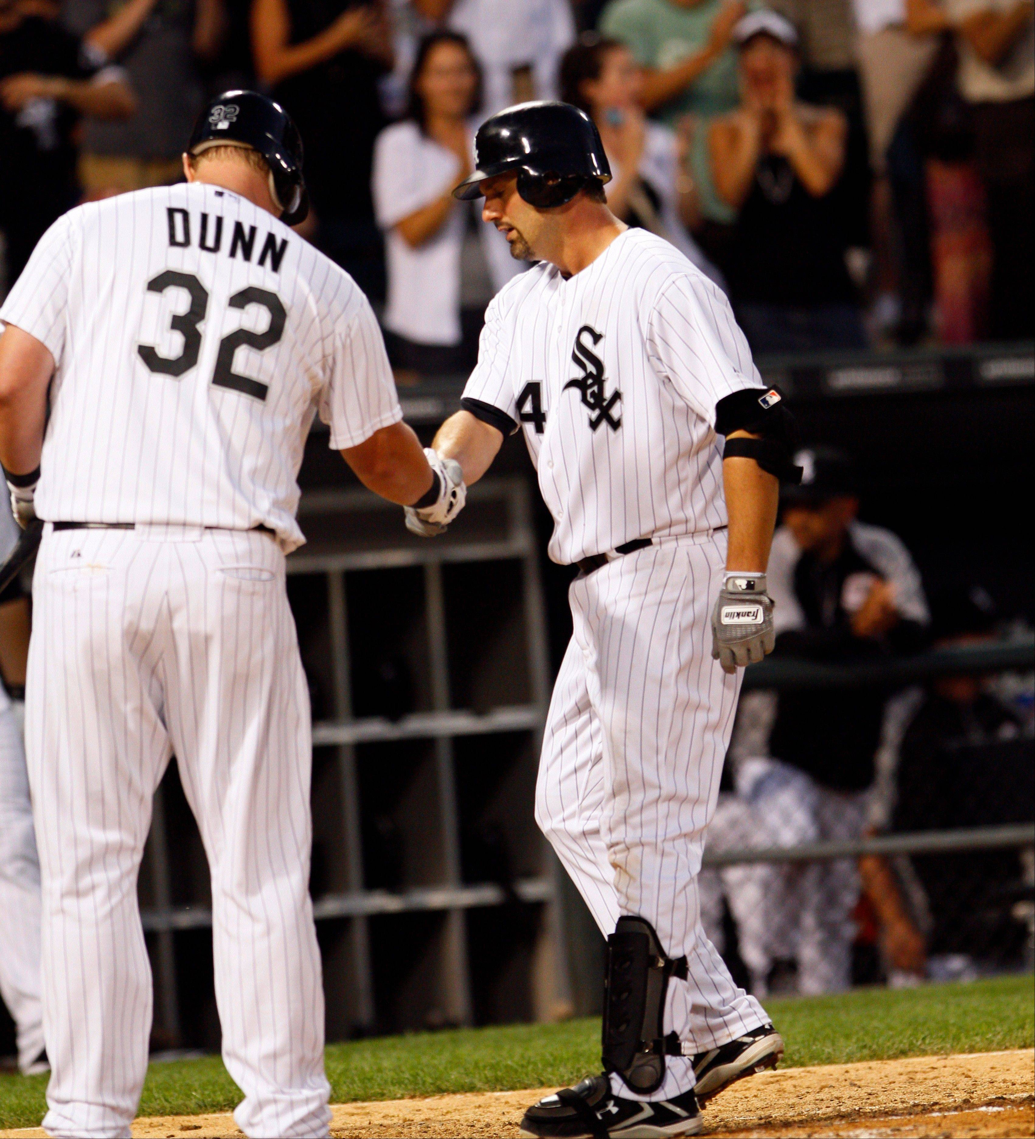 The White Sox�s Paul Konerko, right, gets a handshake from teammate Adam Dunn after hitting a solo home run in the seventh inning against Red Sox on Saturday night at U.S. Cellular Field.
