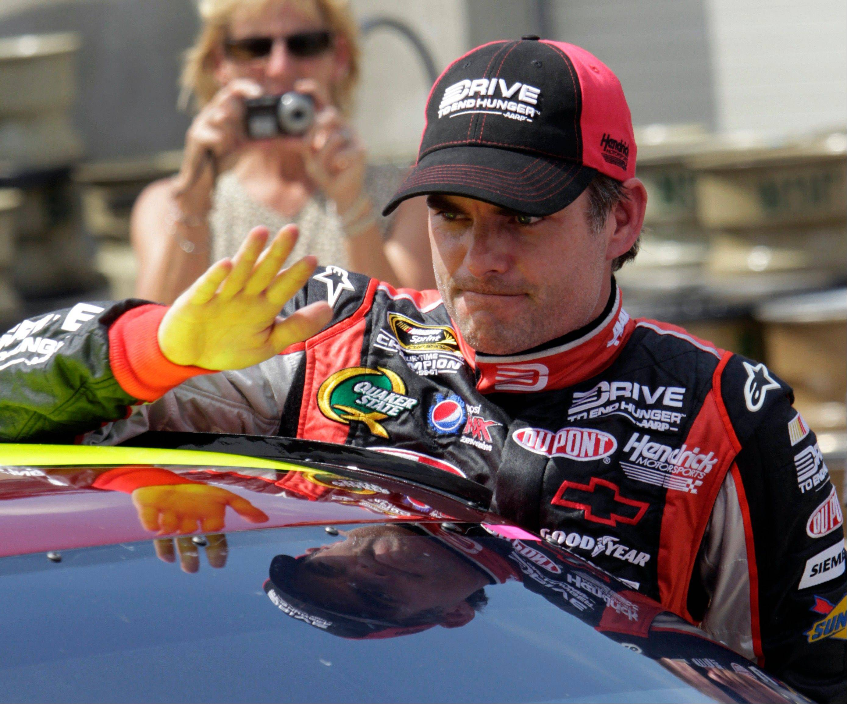Jeff Gordon climbs out of his car Saturday after he qualified for the NASCAR Brickyard 400 auto race at the Indianapolis Motor Speedway in Indianapolis.