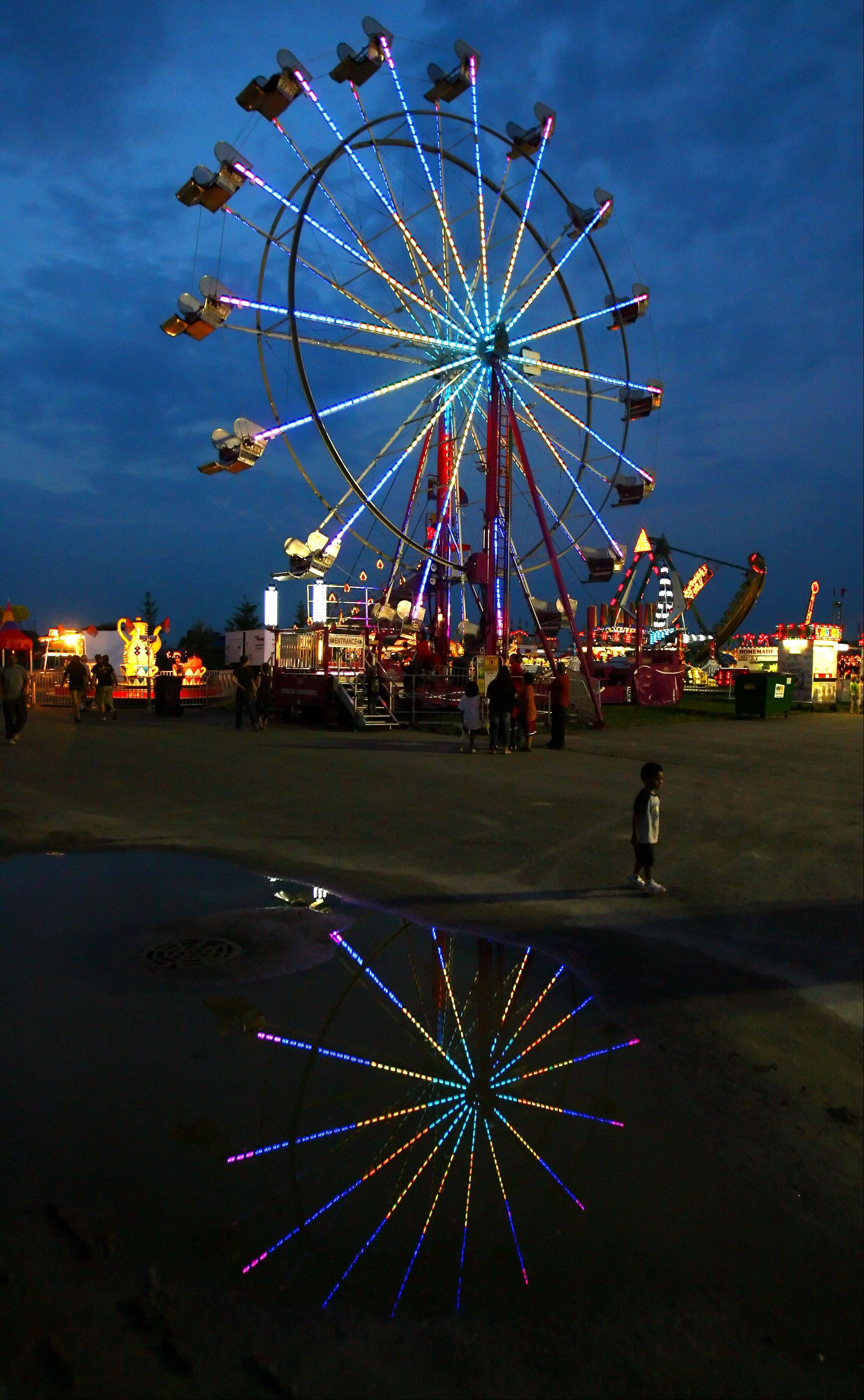The Ferris wheel lights up the night sky at the Lake County Fair.