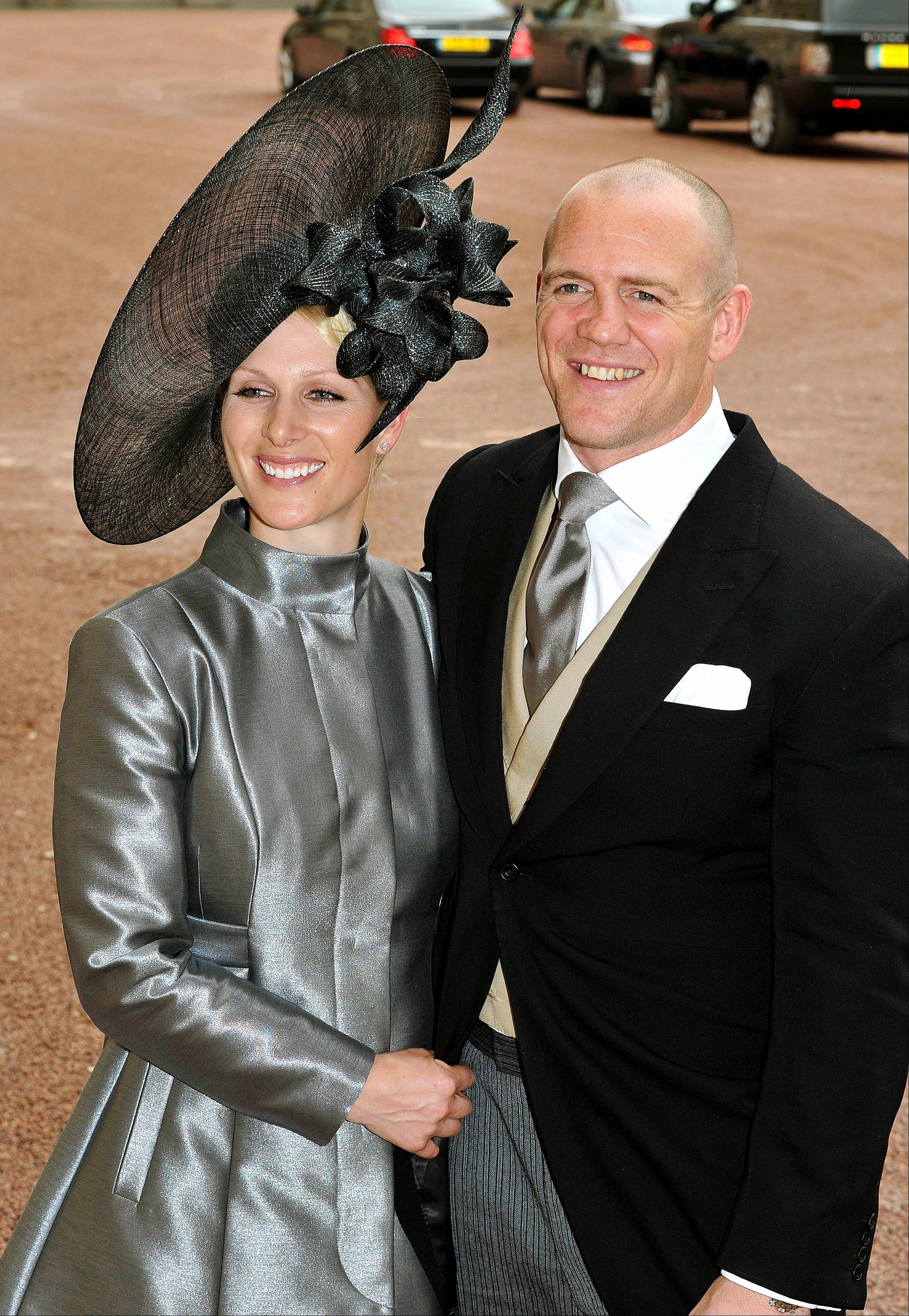 Zara Phillips, left, and her fiance Mike Tindall leave the wedding reception for Britain's Prince William and Catherine Middleton at Buckingham Palace, London. Britain will celebrate its second royal wedding of the season Saturday, July 30, 2011, with equestrian star Zara Phillips - eldest granddaughter of Queen Elizabeth II - set to take center stage as she marries England rugby stalwart Mike Tindall.