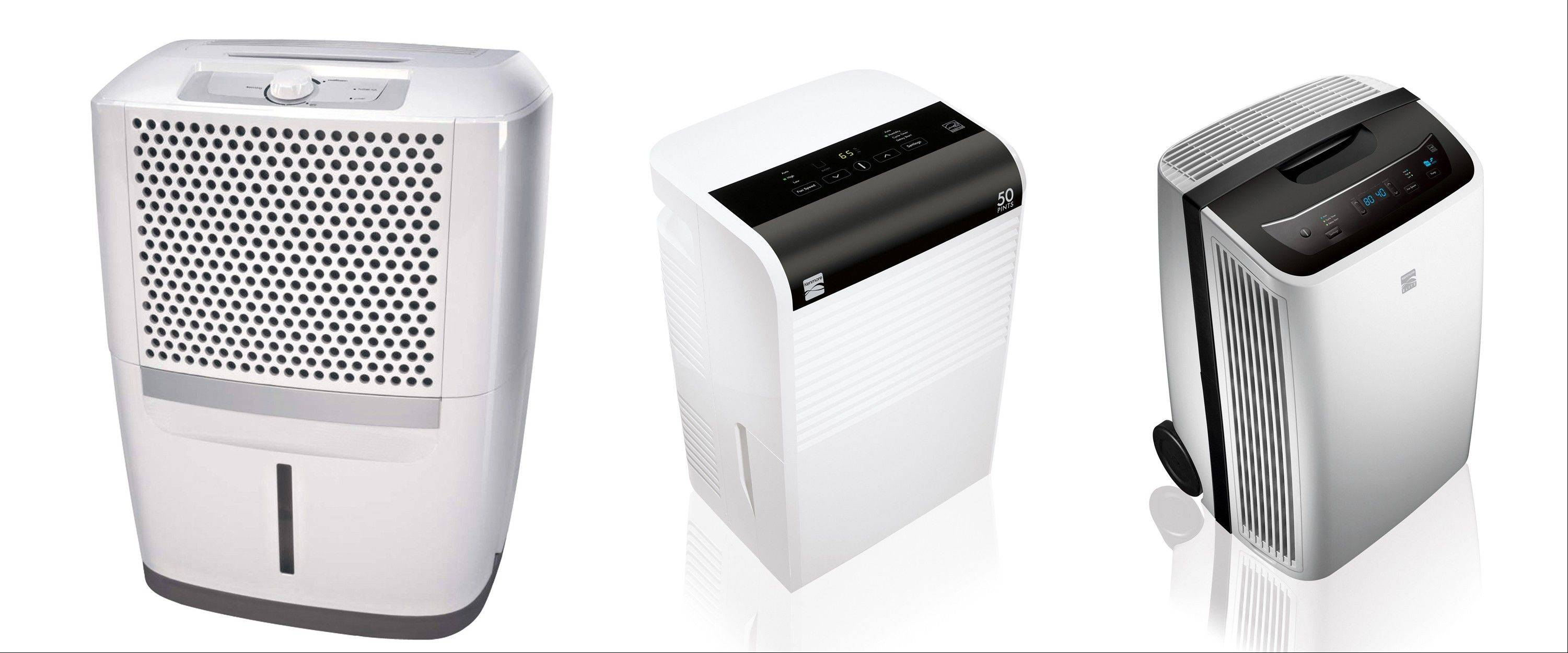 With wet, muggy weather common in the Midwest, homeowners are turning on their dehumidifiers to take moisture out of the air. Some examples are, from left, the Frigidaire 30-pint dehumidifier, the Kenmore 50-pint dehumidifier and the Kenmore Elite 70-pint dehumidifier.
