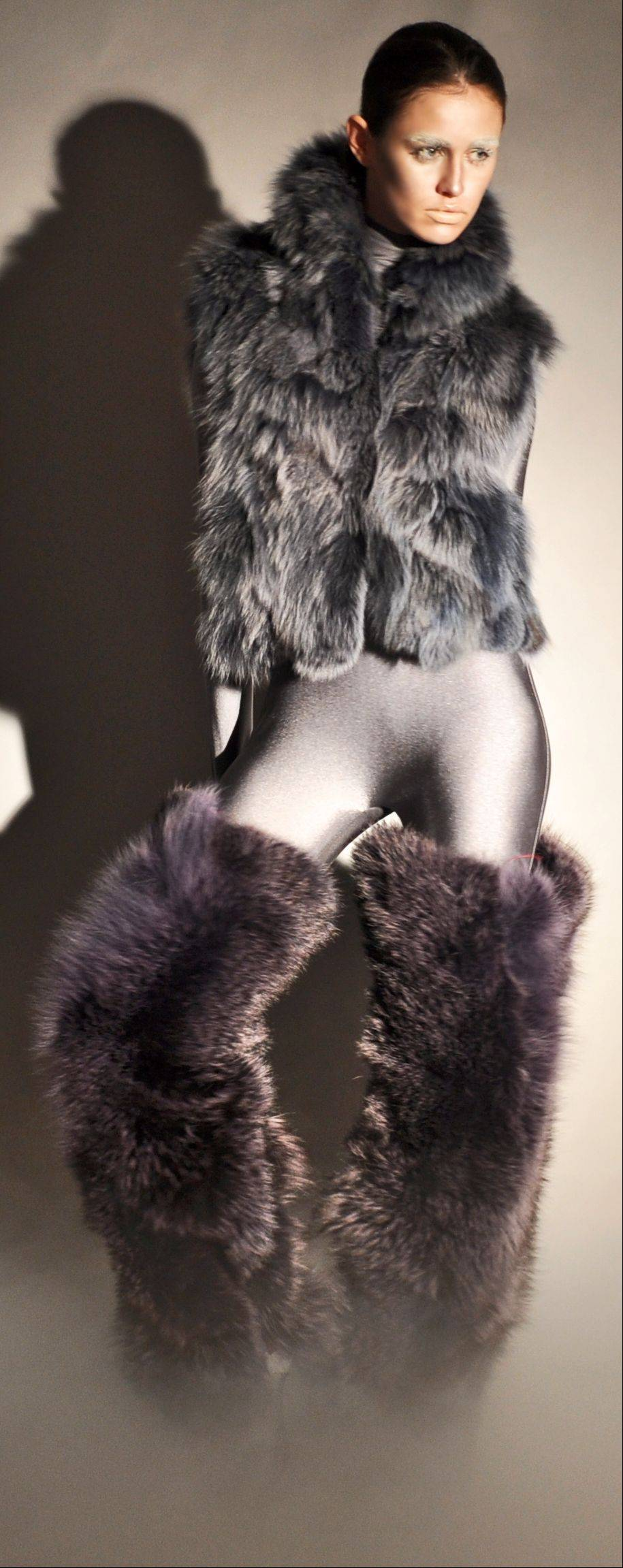 An indigo dyed fox vest and thigh-high purple coyote fur leg warmers, part of Adrienne Landau's fall 2011 collection.