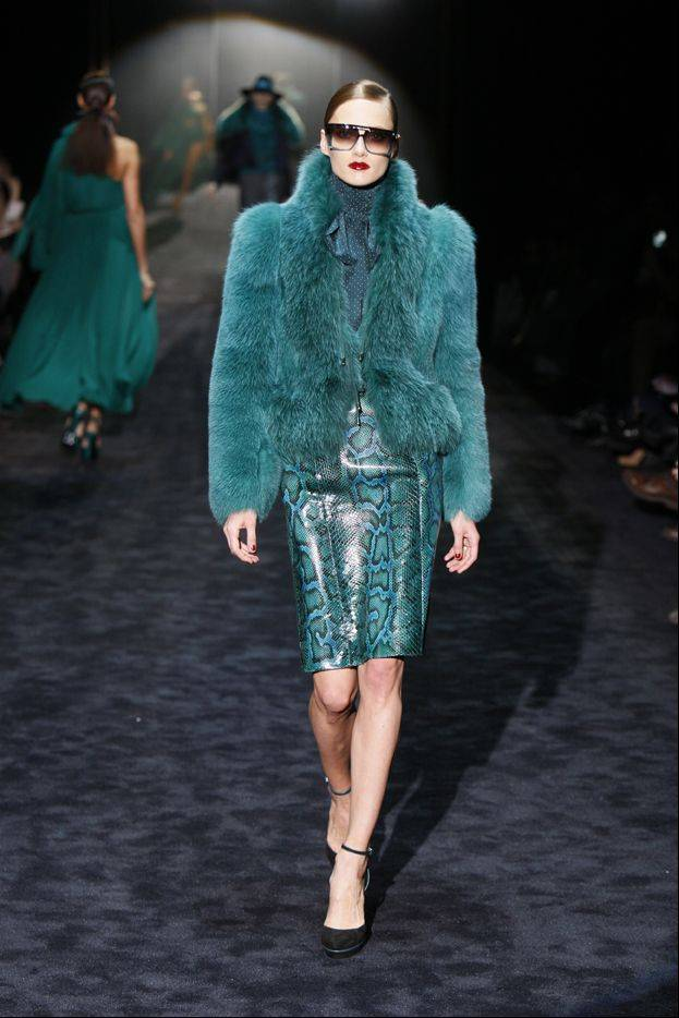 A fur coat designed by Gucci is modeled for the presentation of Gucci's 2011 Fall/Winter collection.