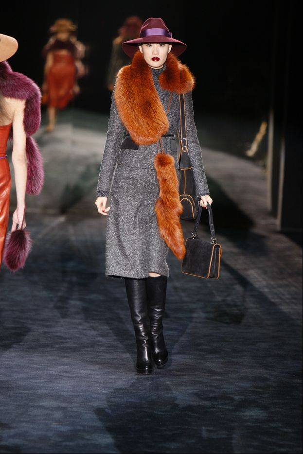 A fur stole designed by Gucci is modeled for the presentation of Gucci's 2011 Fall/Winter collection. Women's tastes are becoming more refined and younger customers are warming up to fur amid efforts to market pelts as more humane products. Source: