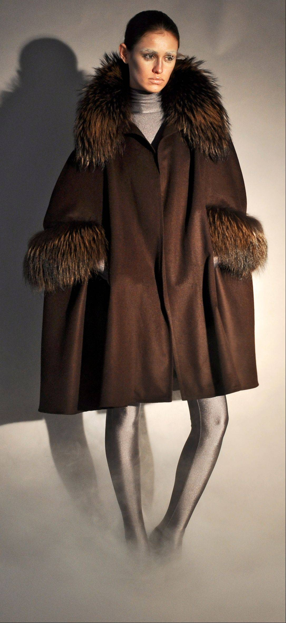A brown cashmere cape coat with raccoon collar and raccoon arm holes, part of Adrienne Landau's fall 2011 collection,. Women's tastes are becoming more refined and younger customers are warming up to fur amid efforts to market pelts as more humane products. S