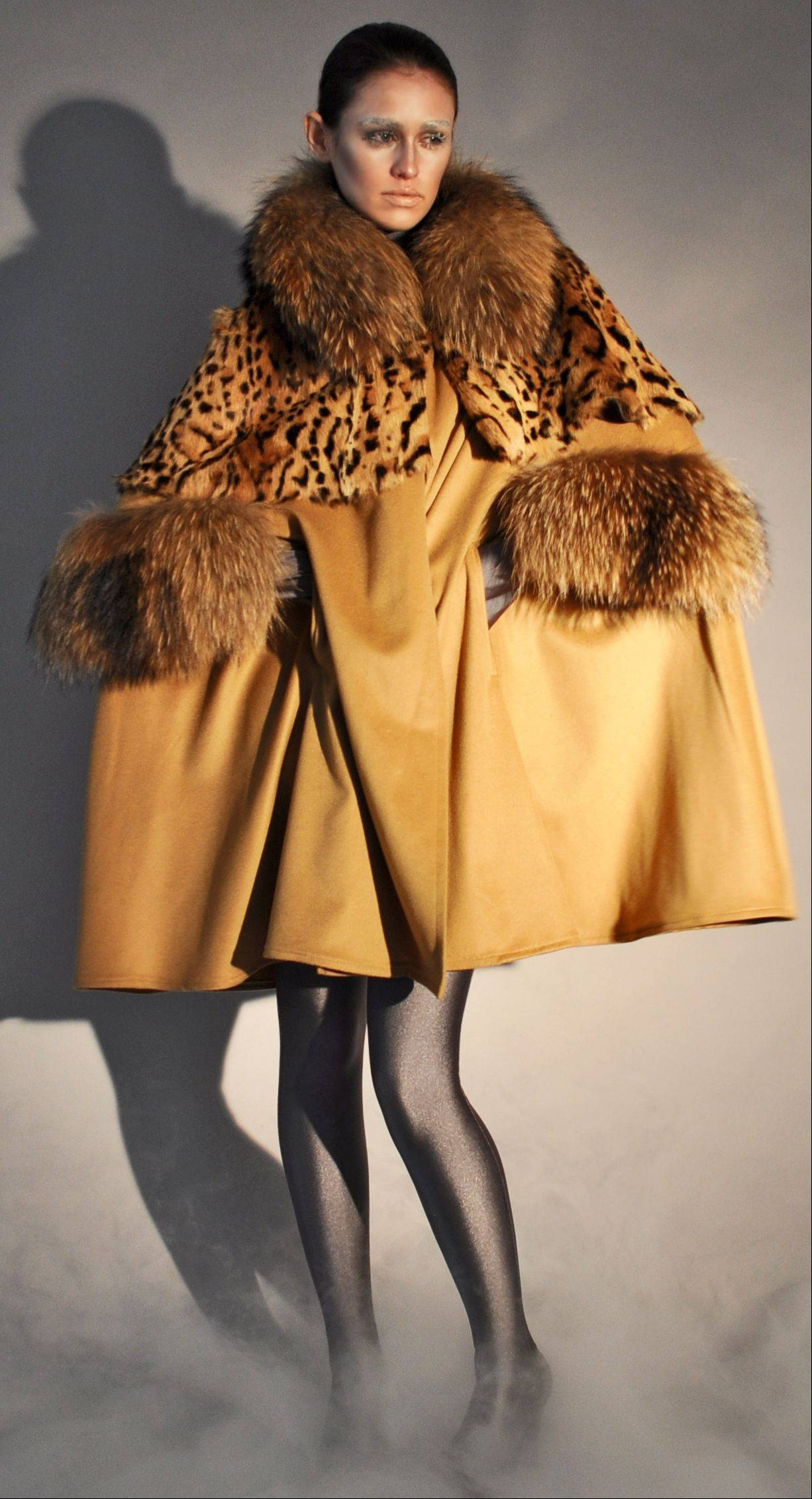 A camel cashmere cape coat with raccoon collar and raccoon arm holes, part of Adrienne Landau's fall 2011 collection,. Women's tastes are becoming more refined and younger customers are warming up to fur amid efforts to market pelts as more humane products.