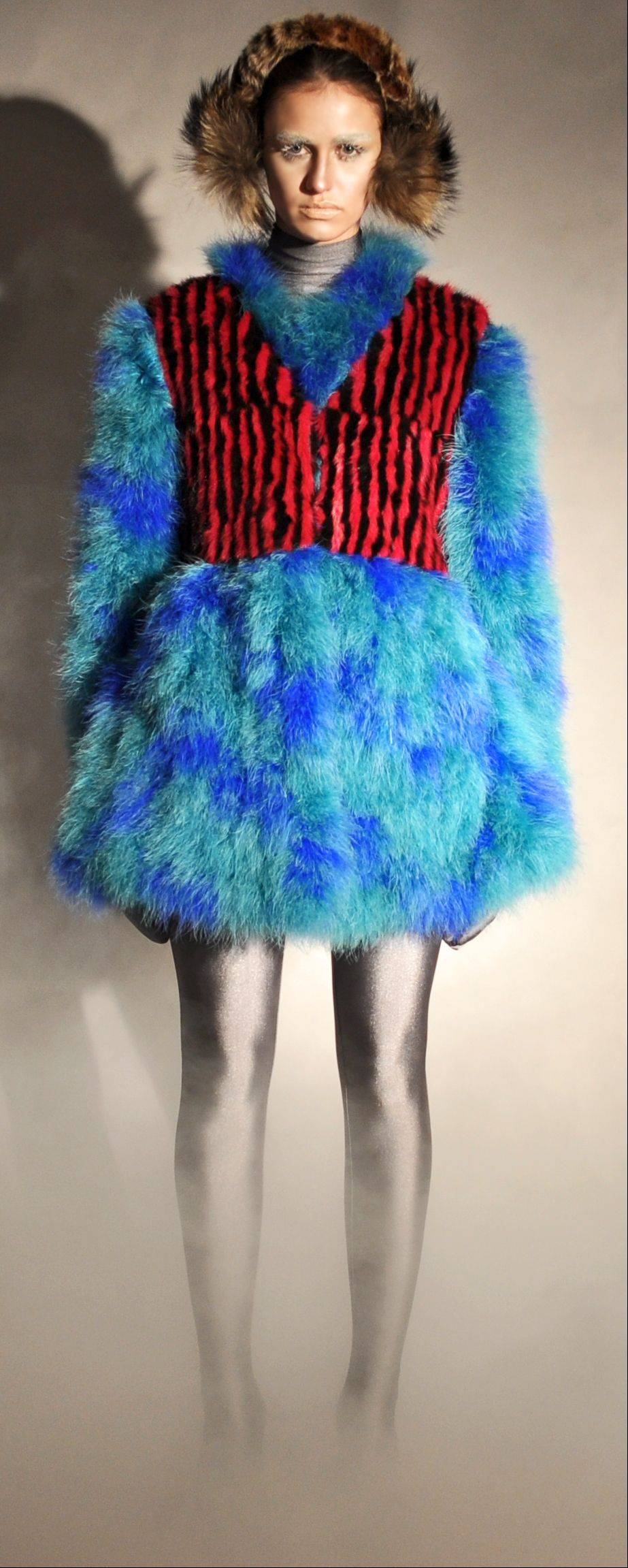 Leopard printed rabbit earmuffs with raccoon puffs and a cropped mink striped vest, marabou spotted coat, part of Adrienne Landau's fall 2011 collection.