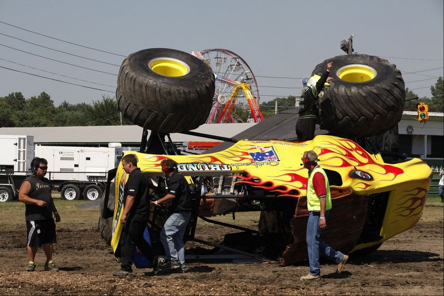 Rick Majewski/rmajewski@dailyherald.comDue to some mud on the track, Outback Thunda driven by Clive Featherby rolled over on its side at the DuPage County Fair in Wheaton on Saturday July 30th 2011.