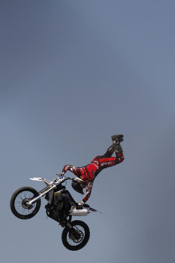 "Deano Dotson performs a ""cliffhanger"" trick 60 feet off the ground Saturday at the DuPage County Fair in Wheaton."