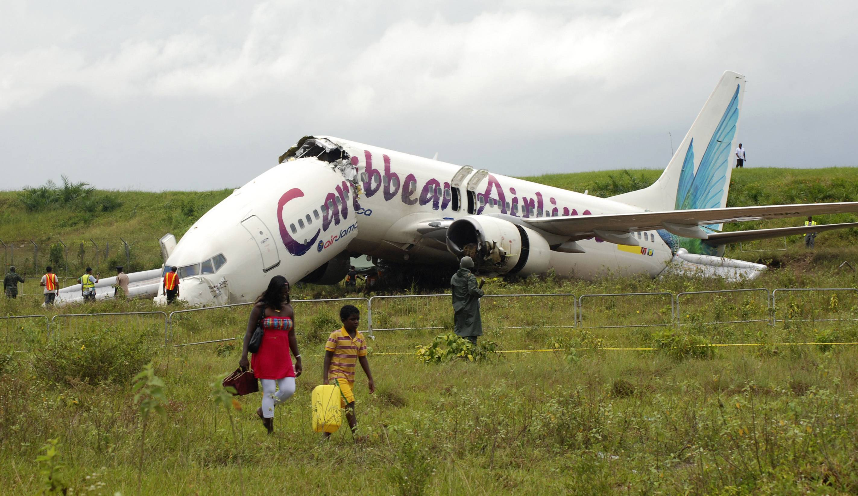 The broken fuselage of a Caribbean Airlines' Boeing 737-800 is seen after it crashed Saturday at the end of the runway at Cheddi Jagan International Airport in Timehri, Guyana. The Caribbean Airlines flight 523 from New York touched down on the rainy runway, slid through a chain-link fence and broke apart just short of a ravine but there were no immediate reports of death among the 163 people aboard, despite several dozen of injuries.