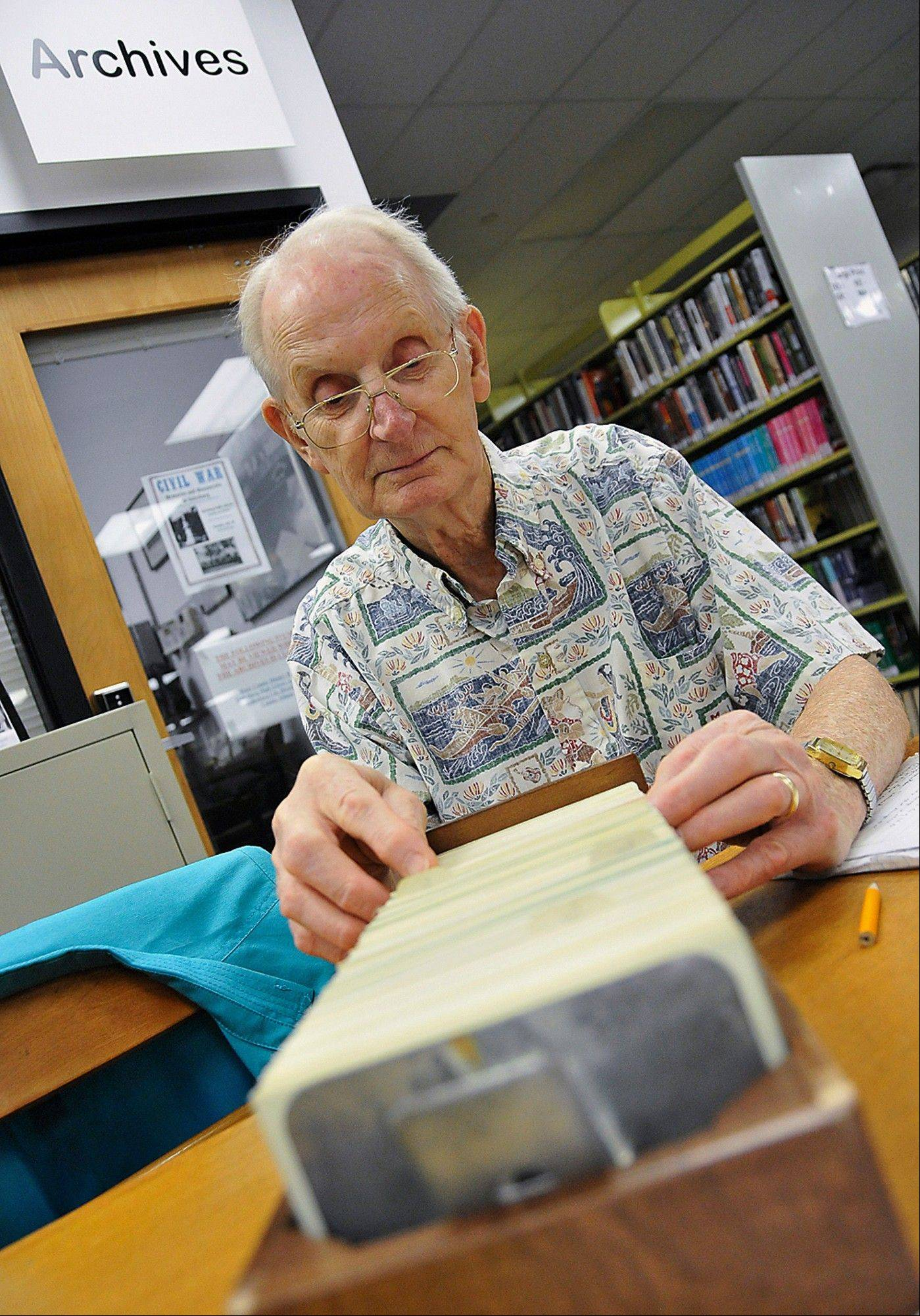 Ray Wilson of Abingdon, Ill., consults files from the archives at the Galesburg Public Library genealogy lock-in. Enthusiasts were locked inside for several hours to hunt and search for missing links in their ancestry.
