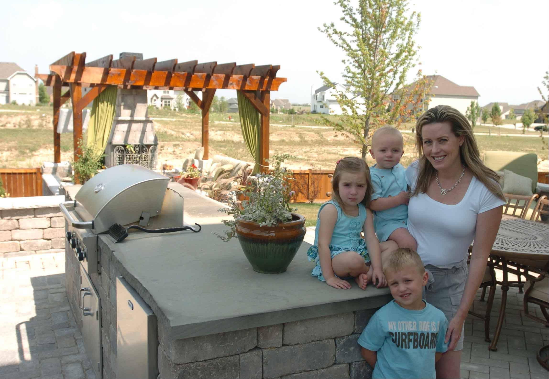 Amanda Jakovich shows off her new backyard with Alison, 3; Jack, 1; and Jake, 4.