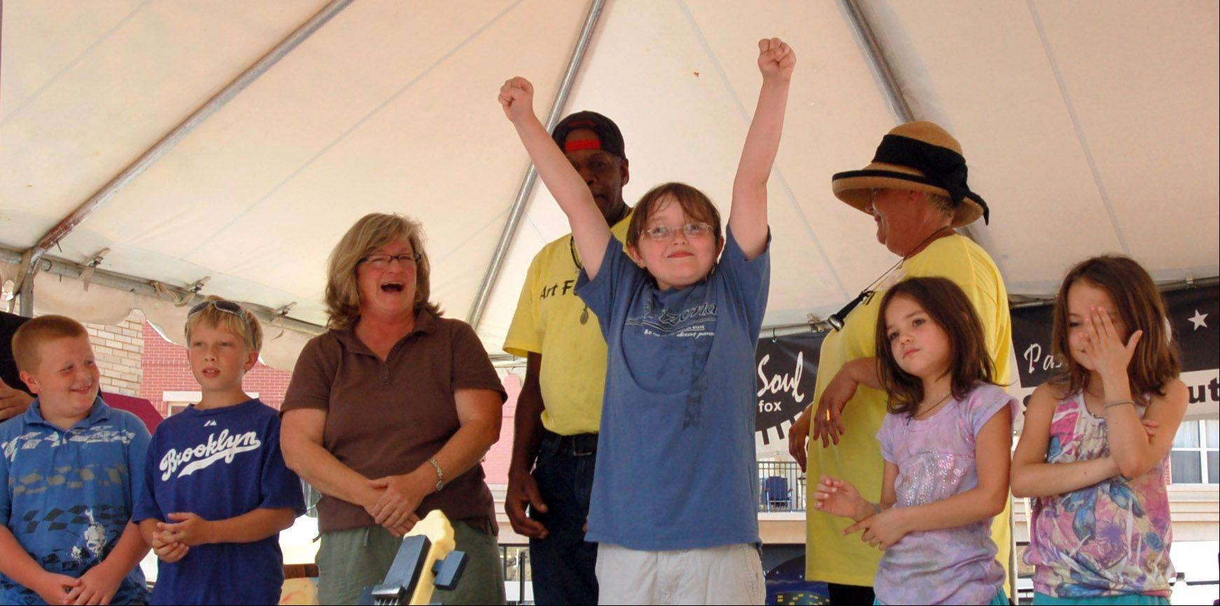 Max Moring of Elgin, 10, won the North American Gurning Championship during the Art and Soul on the Fox/Passeggiatta festival in Elgin on Sunday. Max made the best ugly face, and was chosen the winner by the crowd.