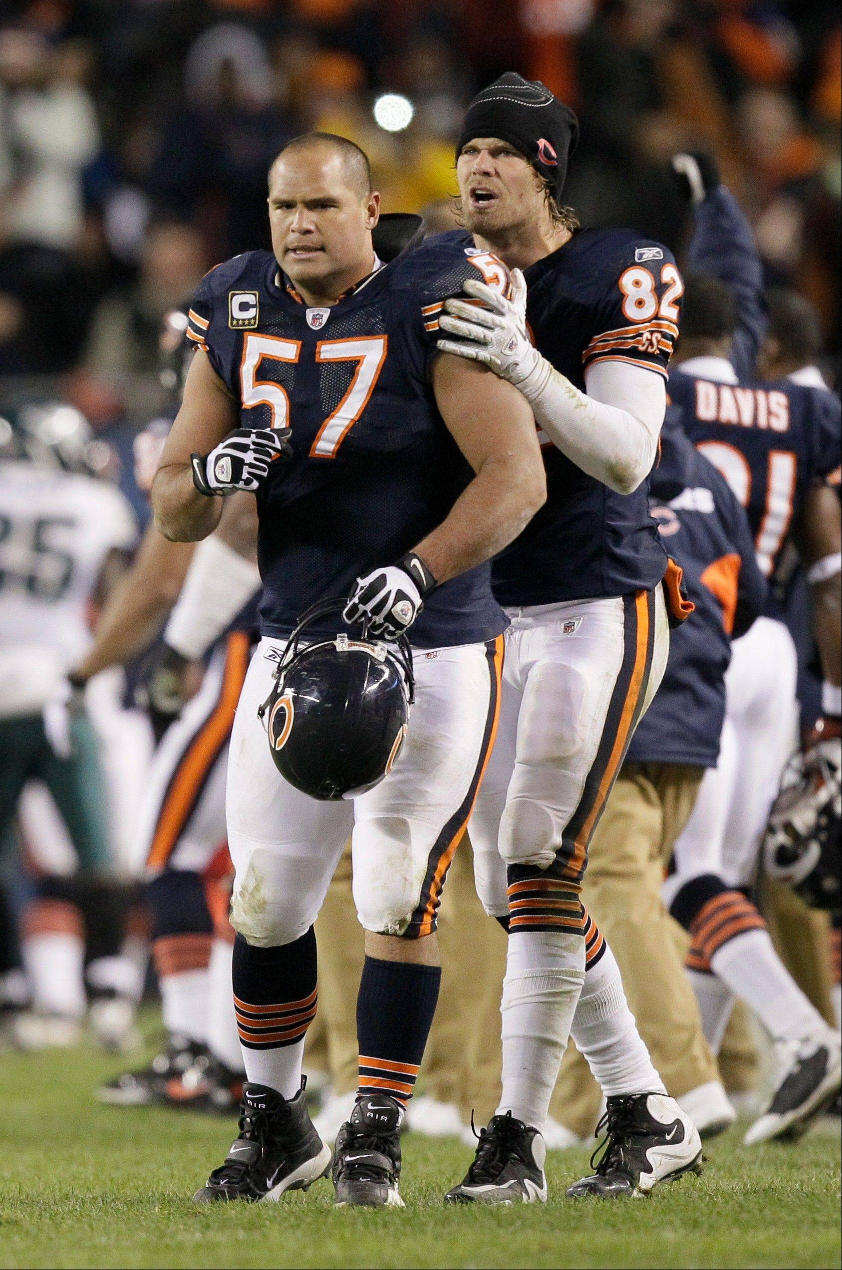 Chicago Bears center Olin Kreutz (57) and tight end Greg Olsen (82) react on the sideline in the second half of an NFL football game against Philadelphia Eagles in Chicago, Sunday, Nov. 28, 2010. (AP Photo/Nam Y. Huh)