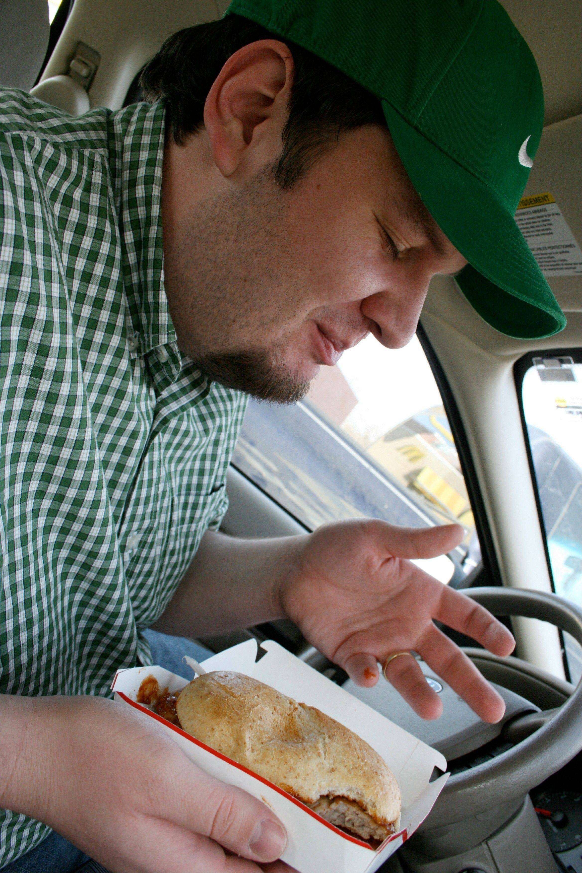 In this Nov. 2007 photo, Alan Klein, a meteorologist in the Minneapolis area, who created the McRib Locator website to help other McRib enthusiasts track where McDonald's is offering the elusive sandwich, enjoys a McRib.